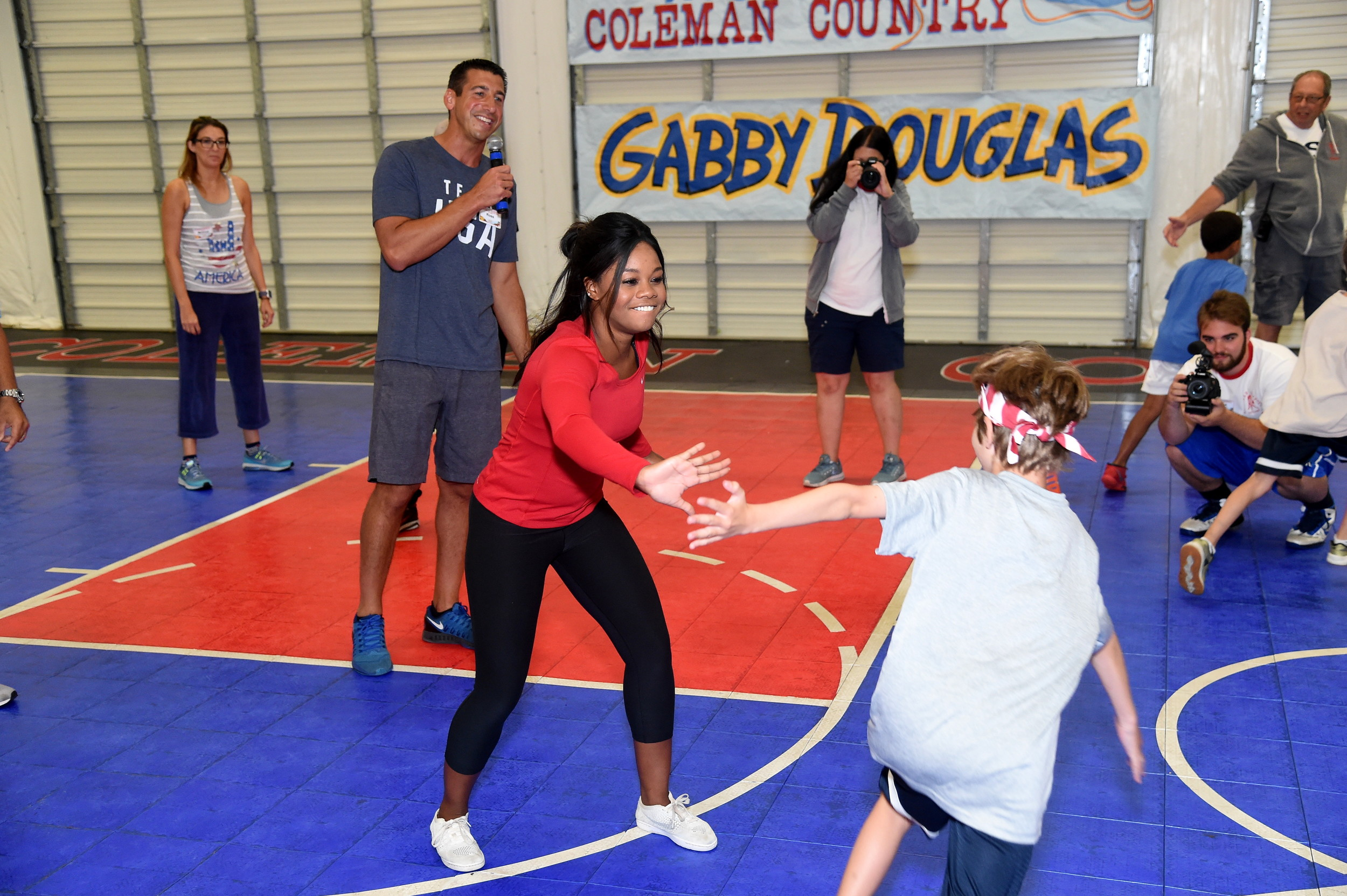 Gabby Douglas, a three-time Olympic gold medalist, made it a point to high-five everyone should could during her visit to Coleman Country Day Camp.
