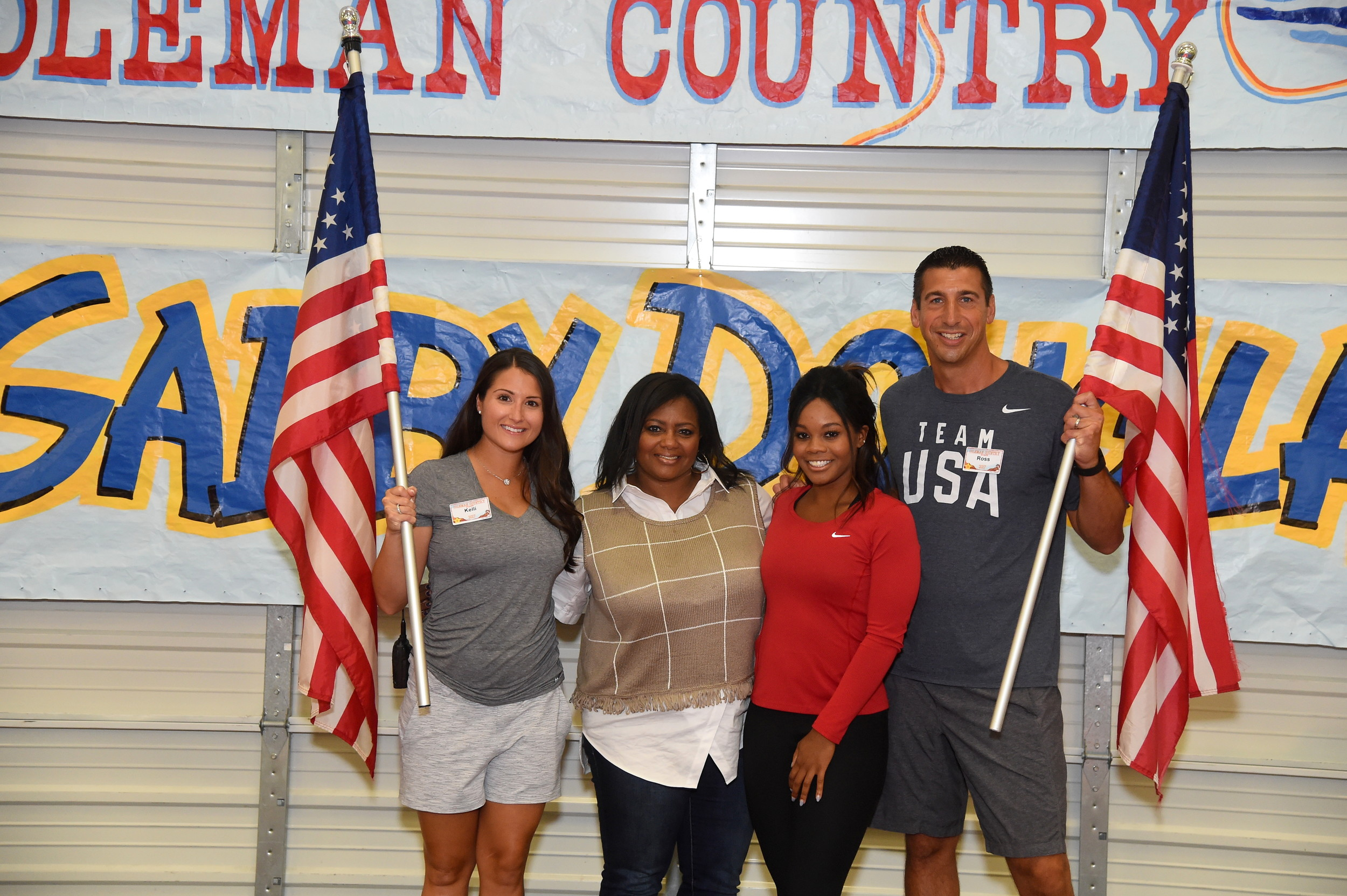 Kelli Coleman, Gabby Douglas's mother Natalie Hawkins and Ross Coleman, joined Douglas for a photo.