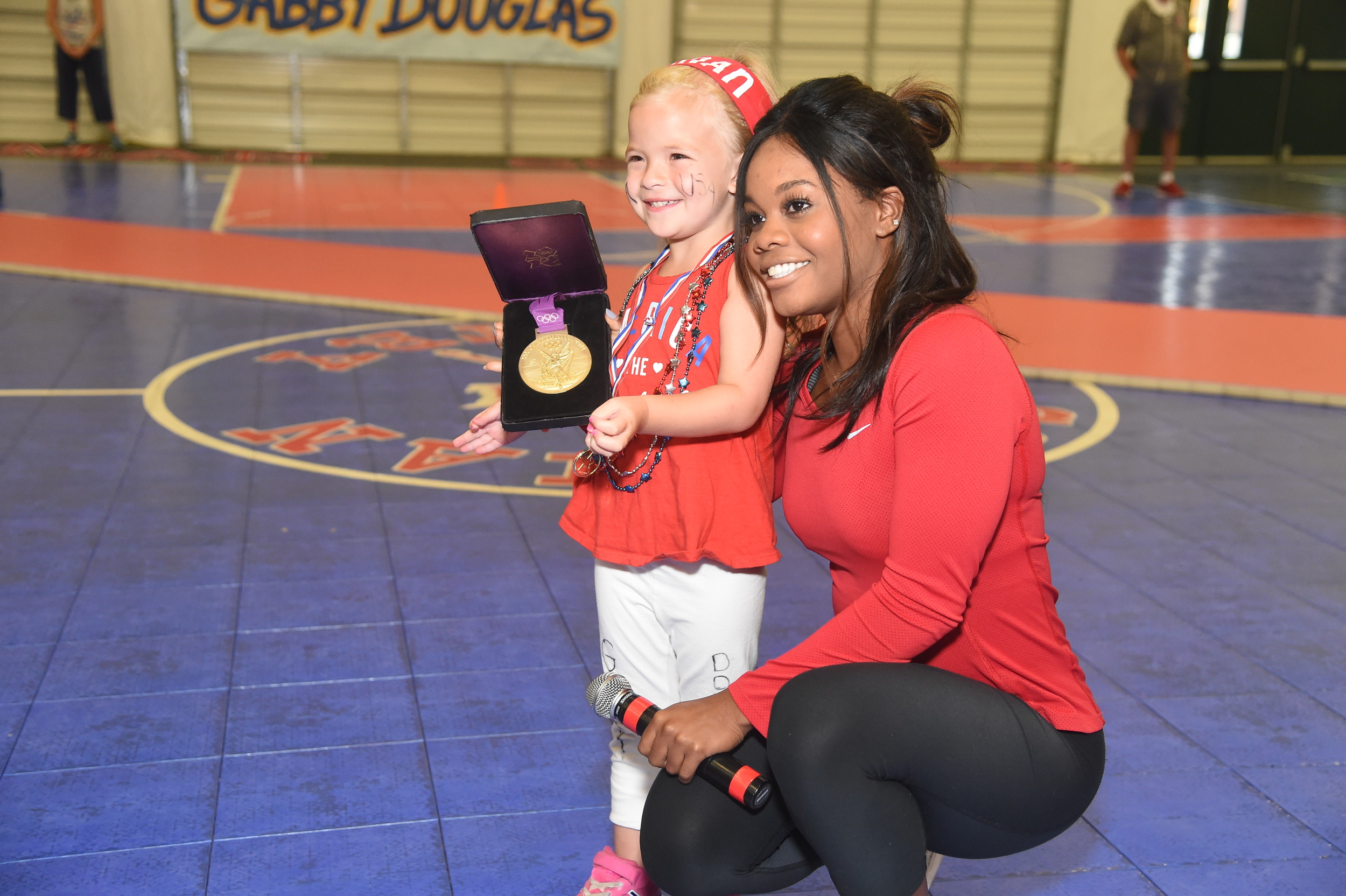 Camper Emma Rice, 5, was thrilled to meet Gabby Douglas and hold one of the Olympian's medals.