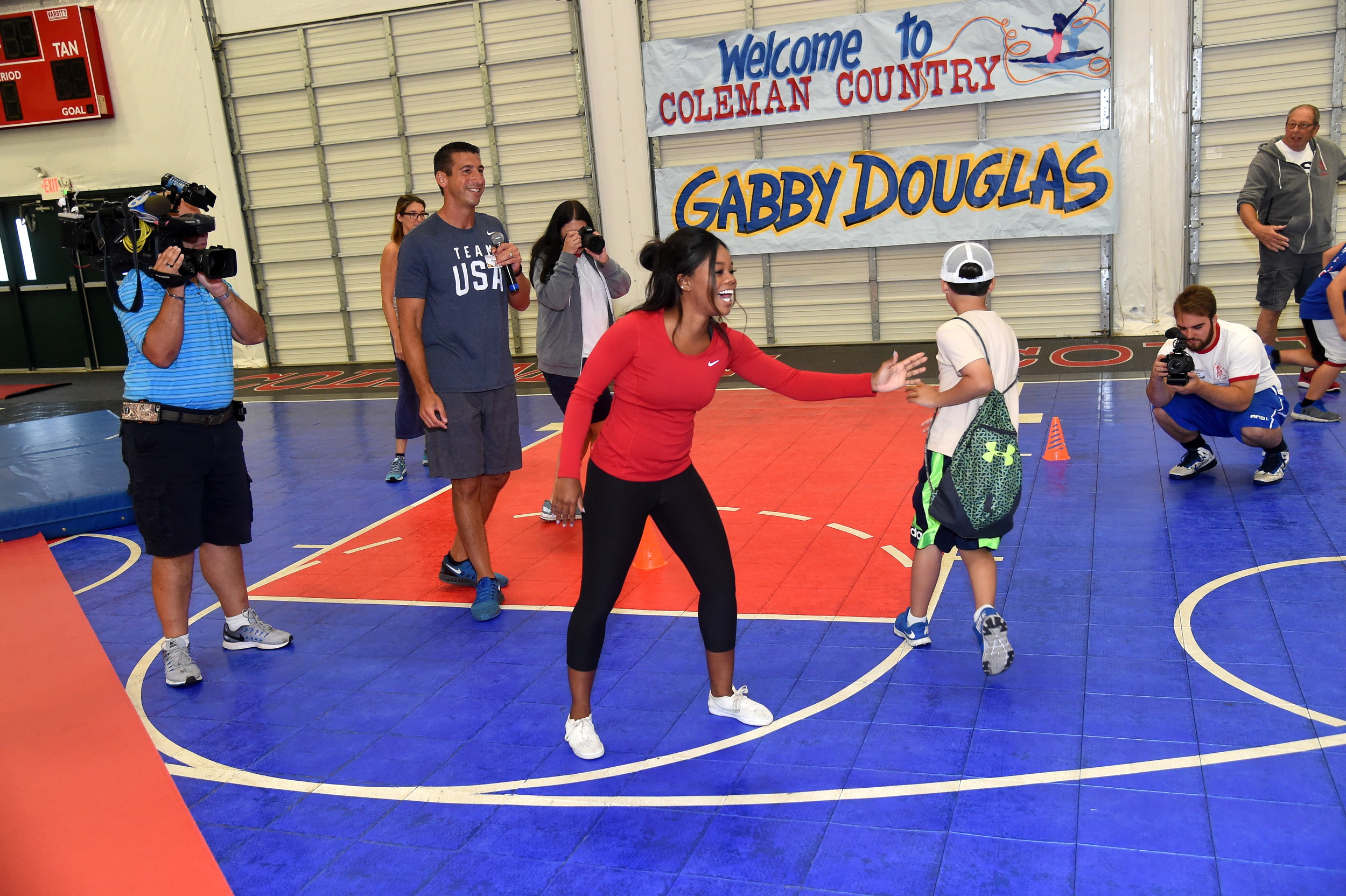 Campers bounded up to give Gabby Douglas high-fives.