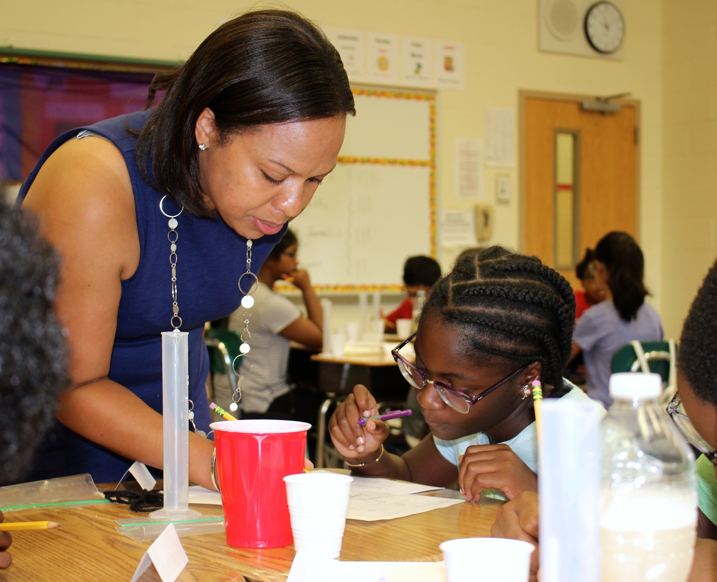 Gotham Avenue School student Anielia Bryan received assistance from teacher Ms. Stacey Taylor during the workshop.