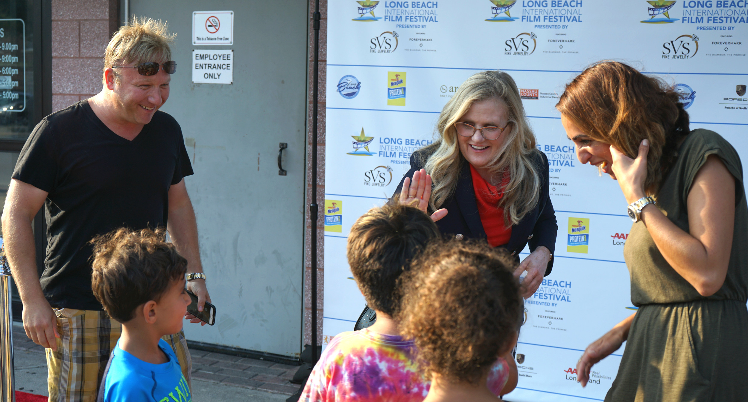 "Actor Nancy Cartwright, center, the voice of Bart Simpson in the animated television series ""The Simpsons,"" greeted fans on Aug. 1, the opening night of the sixth annual Long Beach International Film Festival, at the premiere of a film she produced, ""In Search of Fellini."" Story, more photos, Page 9."