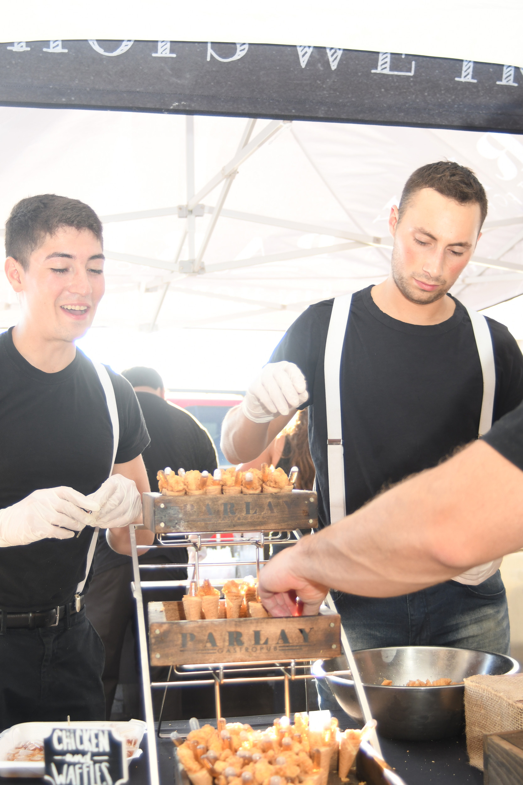 Sean Castaneda, left, and Vincent Lopez of Parlay Gastropub in Rockville Centre, offered hungry guests chicken and waffle cones with maple syrup and macaroni and cheese.