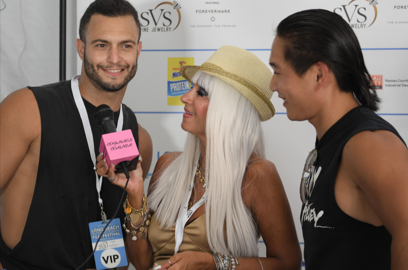 "Joseph Dominic, left, and Matt Cusack, of the band ""City Alley,"" performed at the festival on Aug. 4 and were interviewed on the red carpet by Cognac Wellerlane of Cognac's Corner Magazine."