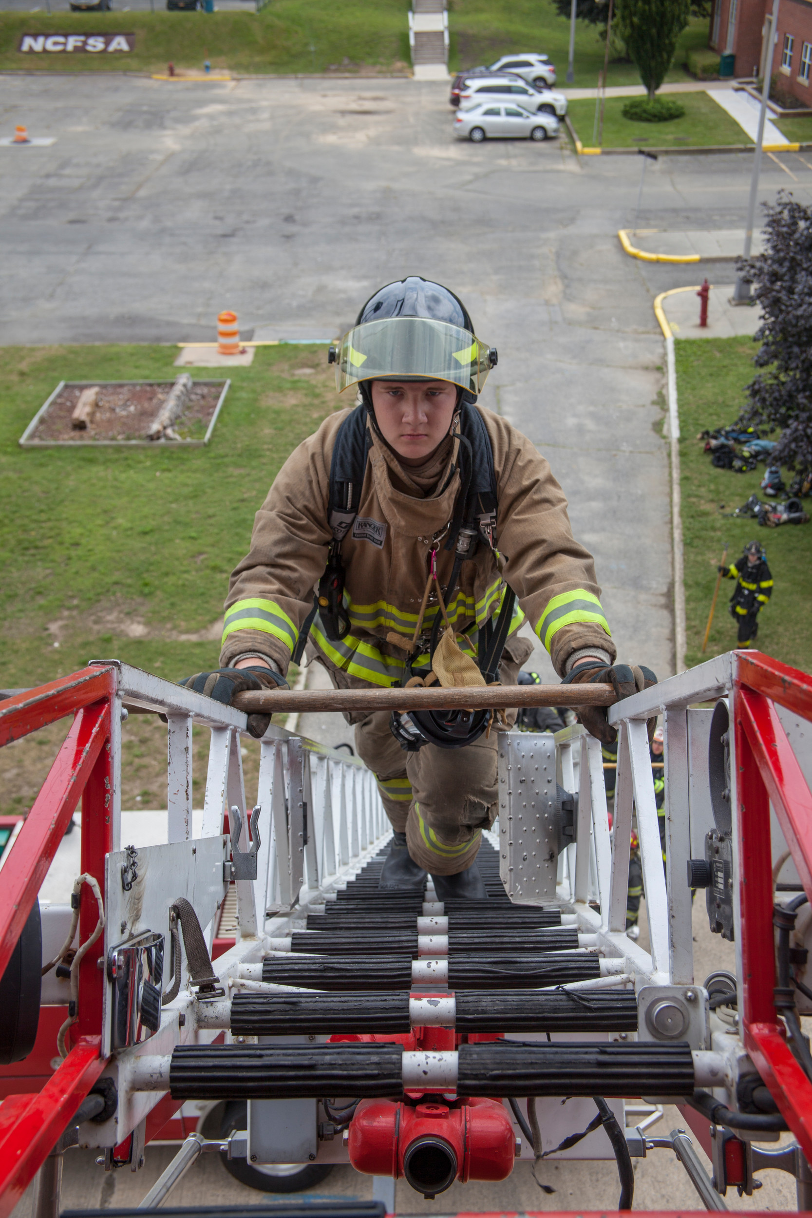 Dan Mannle of Franklin Square climbed up the ladder during the Ladder instruction, one of three topics of the day at the weeklong camp held at The Fire Academy in Bethpage.