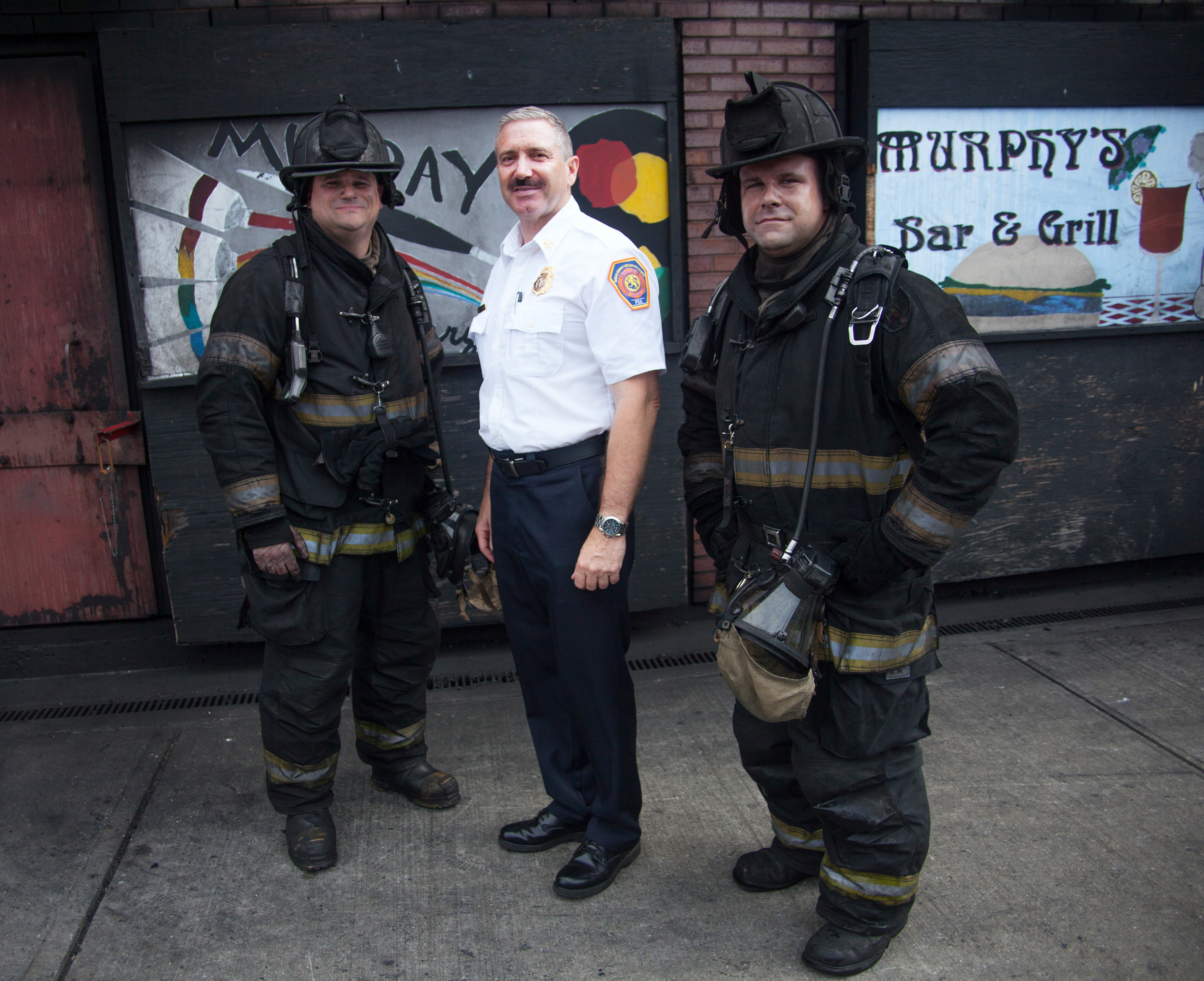 Fire instructors, Chief Gressa of Franklin Square, Chief Hughes and Chief Warner of East Norwich outside the warehouse after the completion of the exercise with the Jr. Firefighters on July 24.