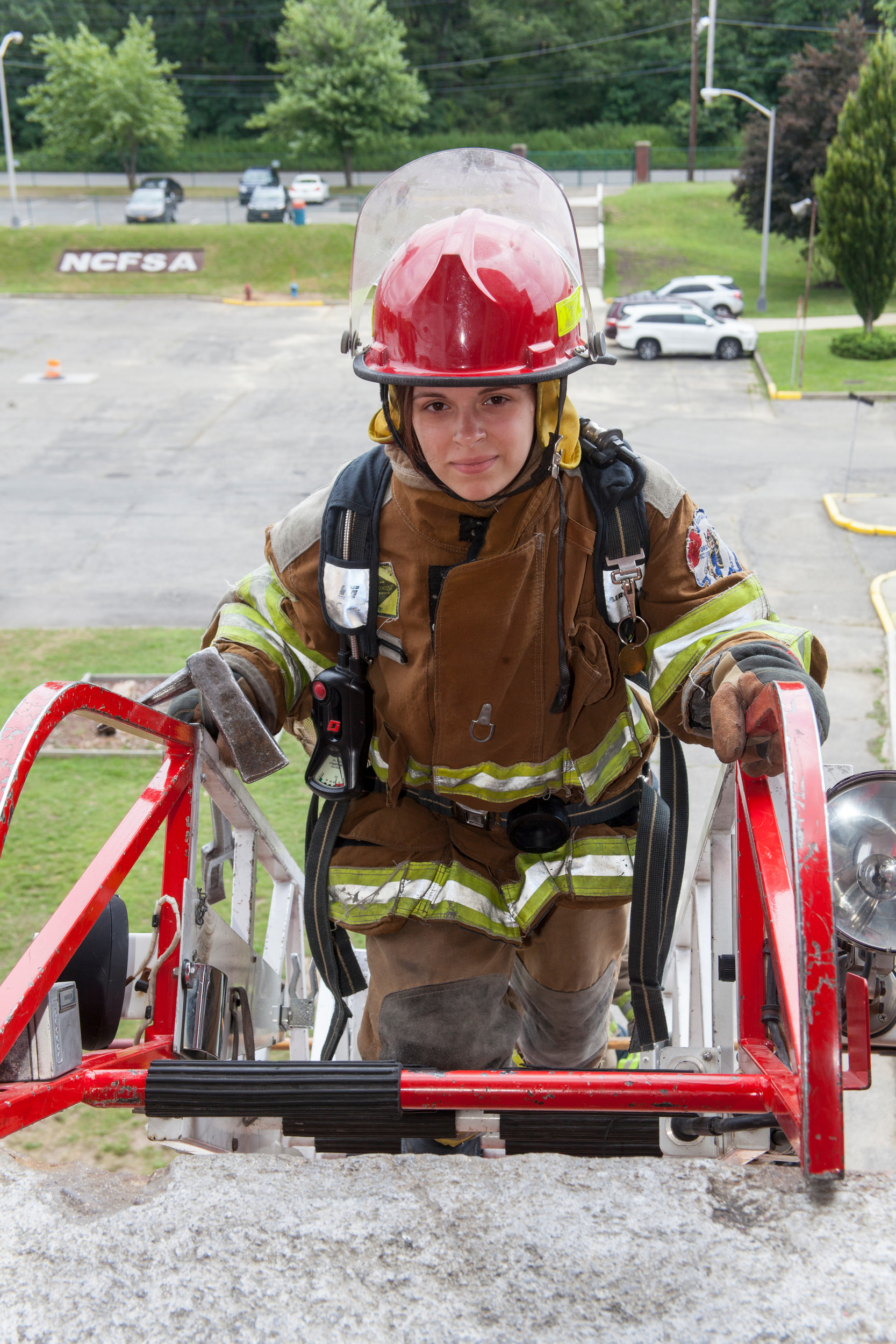 Junior Firefighter, Melanie Sile,s of Franklin Square, climbed the Rescue Ladder three stories high and learned how to enter a burning building at Jr. Fire Camp held at the Fire Academy in Bethpage on July 24.
