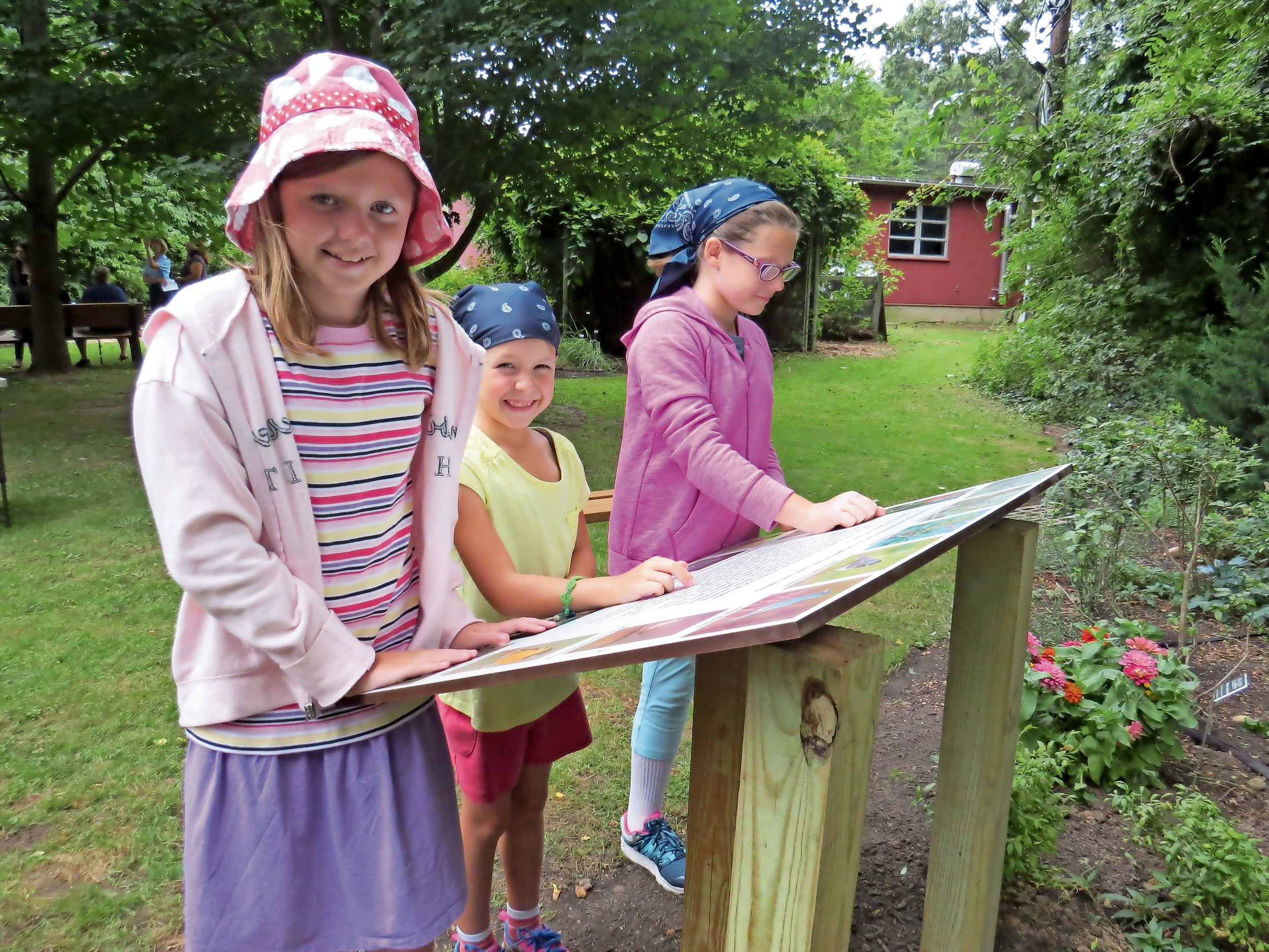 Our feathered friends will be a lot happier when they visit the grounds of Garvies Point Museum and Preserve now that there is a bird-friendly garden. Sisters Elli, left, Juliana and Margaret Collins, ages 11, 7 and 9, checked out the information board to learn all about the birds before going to the garden.