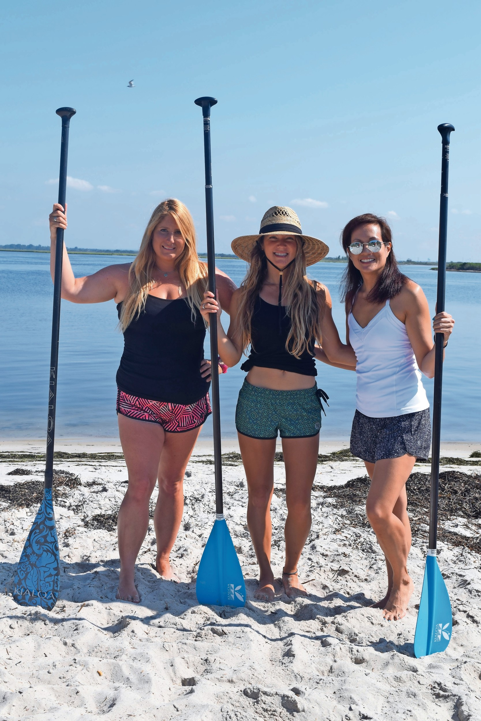 Skudin Surf's Jennifer Hanono, far left, Nicole Glasser and yoga Instructor Lisa Pineda, right, prepared for paddleboard yoga.
