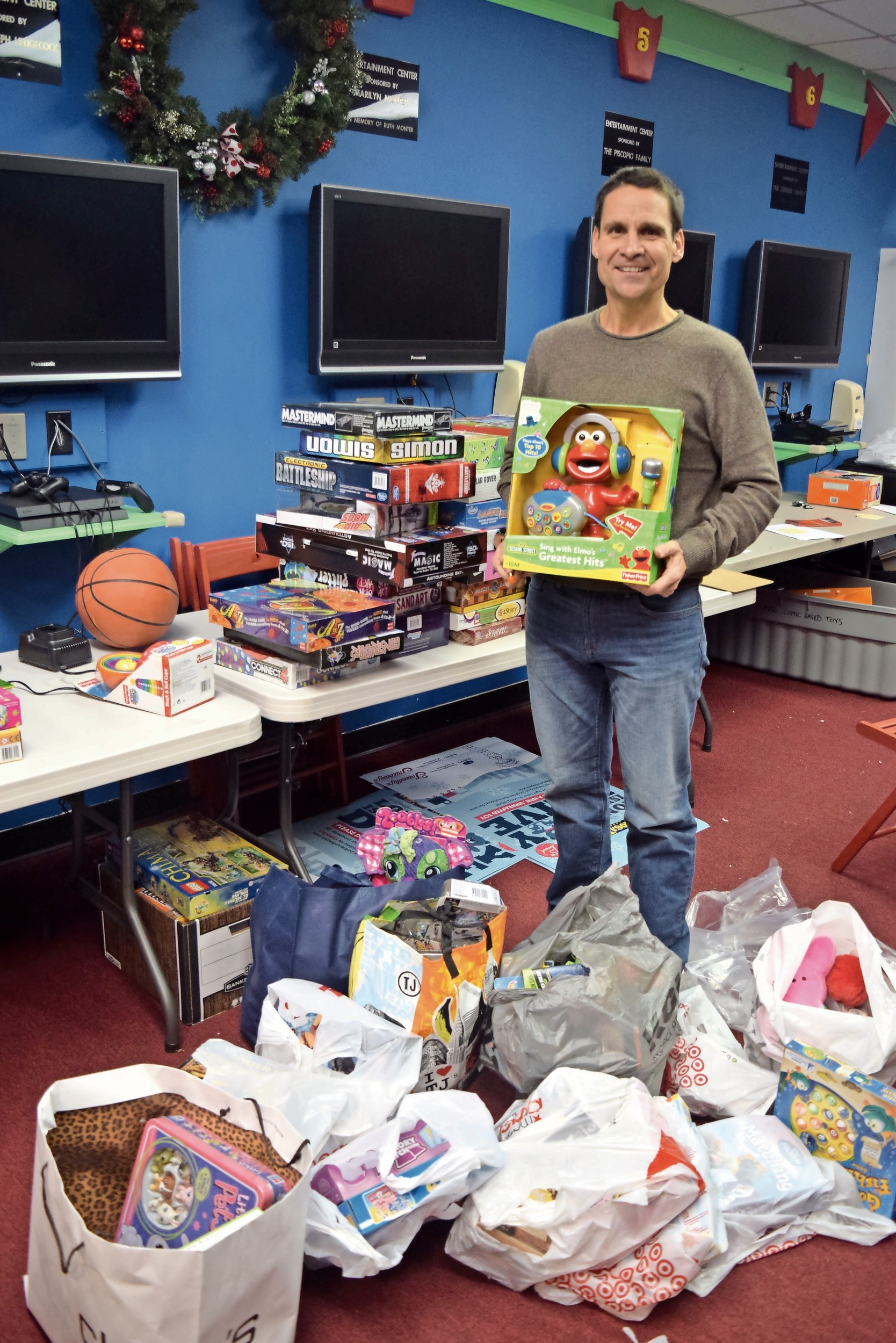John Theissen said that the Wantagh center serves as home base for his charity's annual back-to-school supply and holiday toy drives.