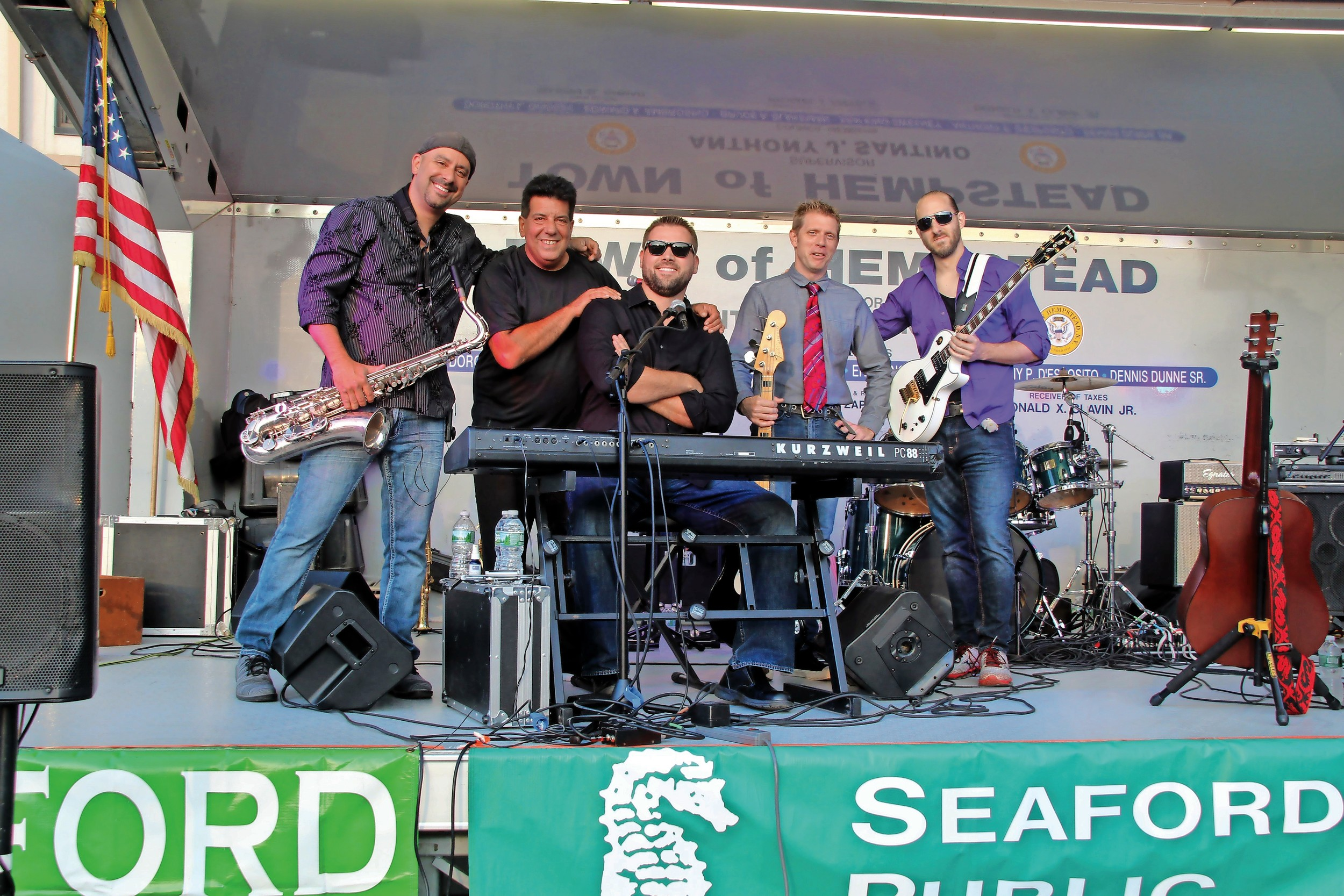 Captain Jack, a beloved local cover band, played Billy Joel and classic rock tunes in Seaford on July 29. From left, Adam Seely, Sal DiMarco, Christian Macchio, Will Shelley and Sal Locascio performed at the concert, which was sponsored by the Seaford Public Library and the Chamber of Commerce.
