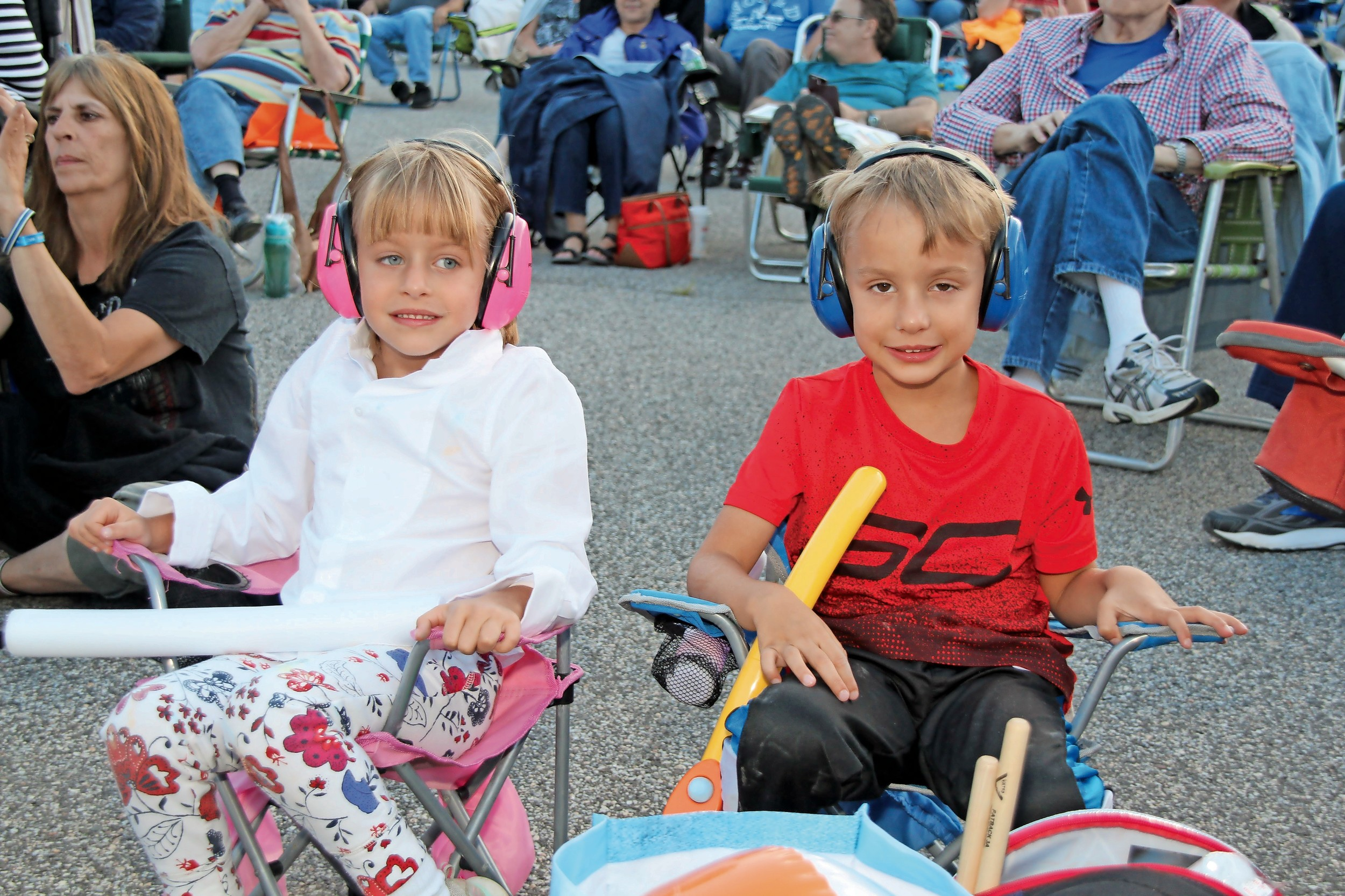 Twins Christopher and Isabelle Seely, 5, wore protective headphones while taking in the sounds of Captain Jack, a Billy Joel cover band that performed at the Seaford Public Library on July 29.