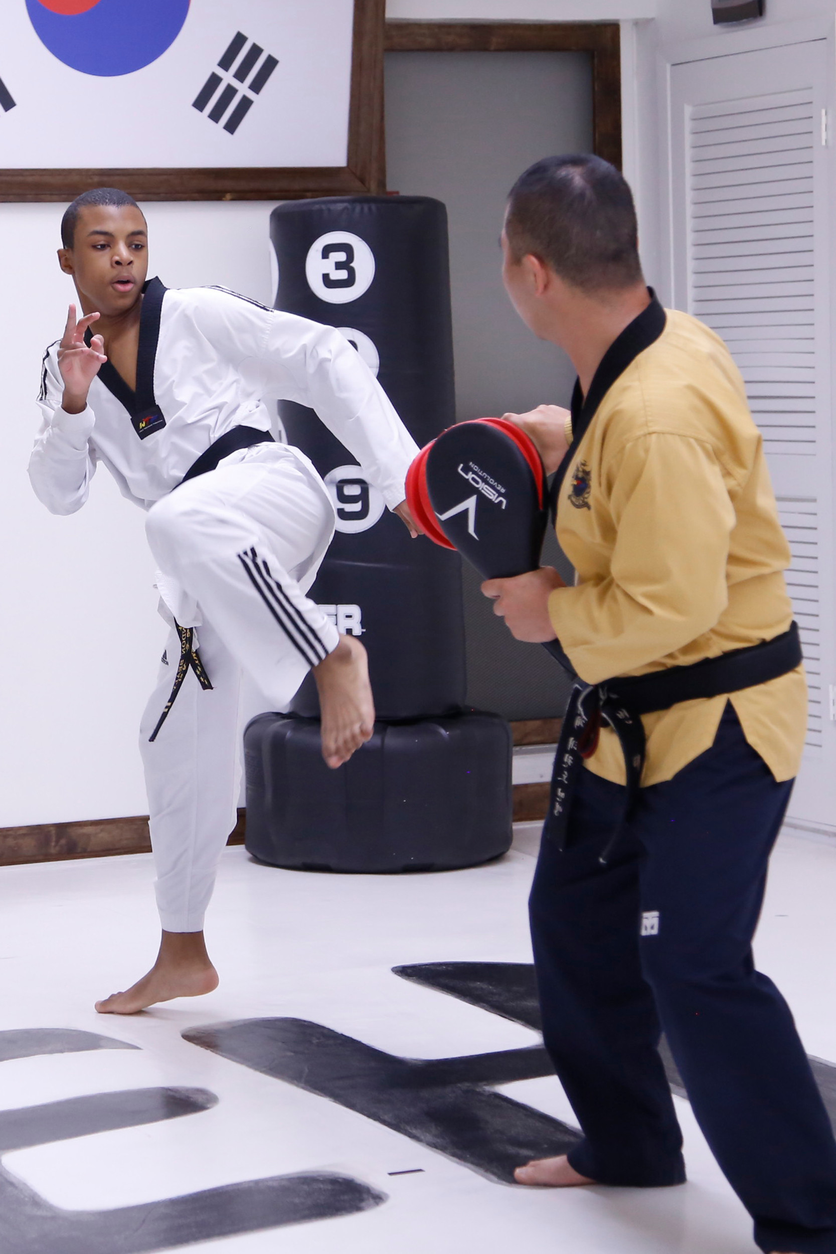 Brandon Sealy sparred with Master Tony Byon on Aug. 4 in preparation for the Junior Pan Am Taekwondo Championship.