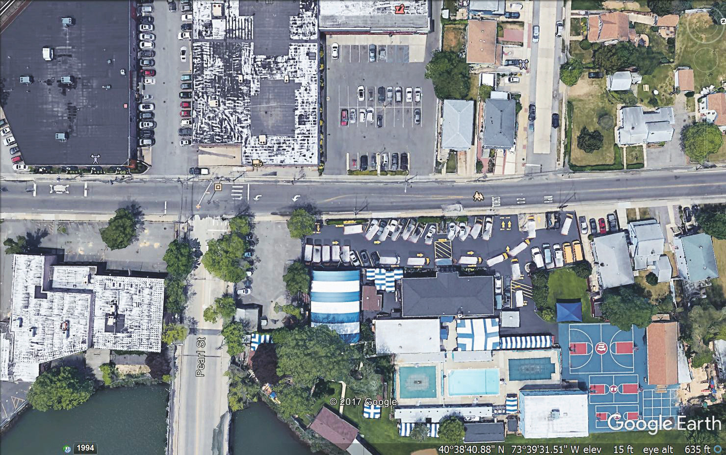 There is a crosswalk at the corner of Ocean Avenue and Pearl Street in East Rockaway, top left, but directors at Rolling River Day Camp are pushing for a stop sign.