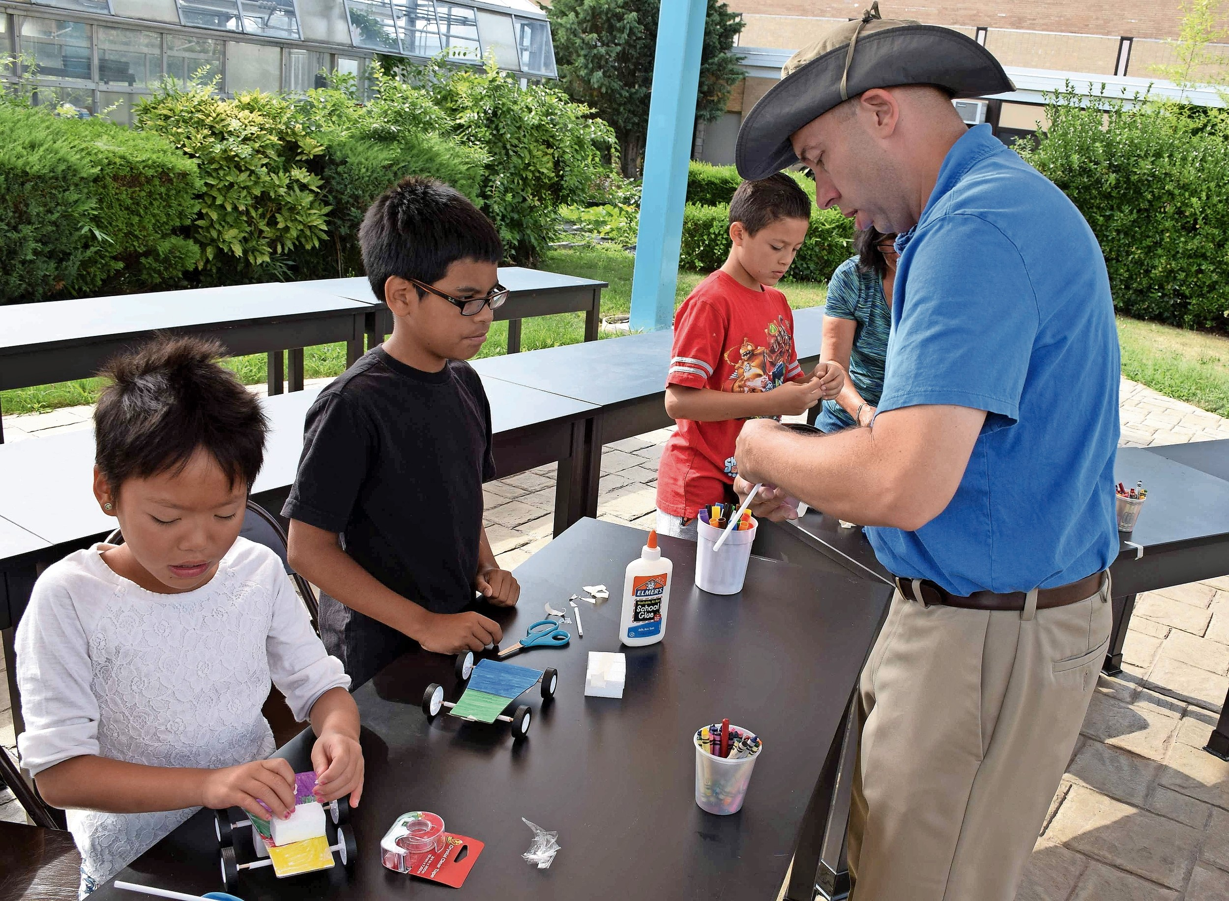 Frank Martin, a science teacher at Jonas Salk Middle School, worked with students as they designed race cars in the STEM class.