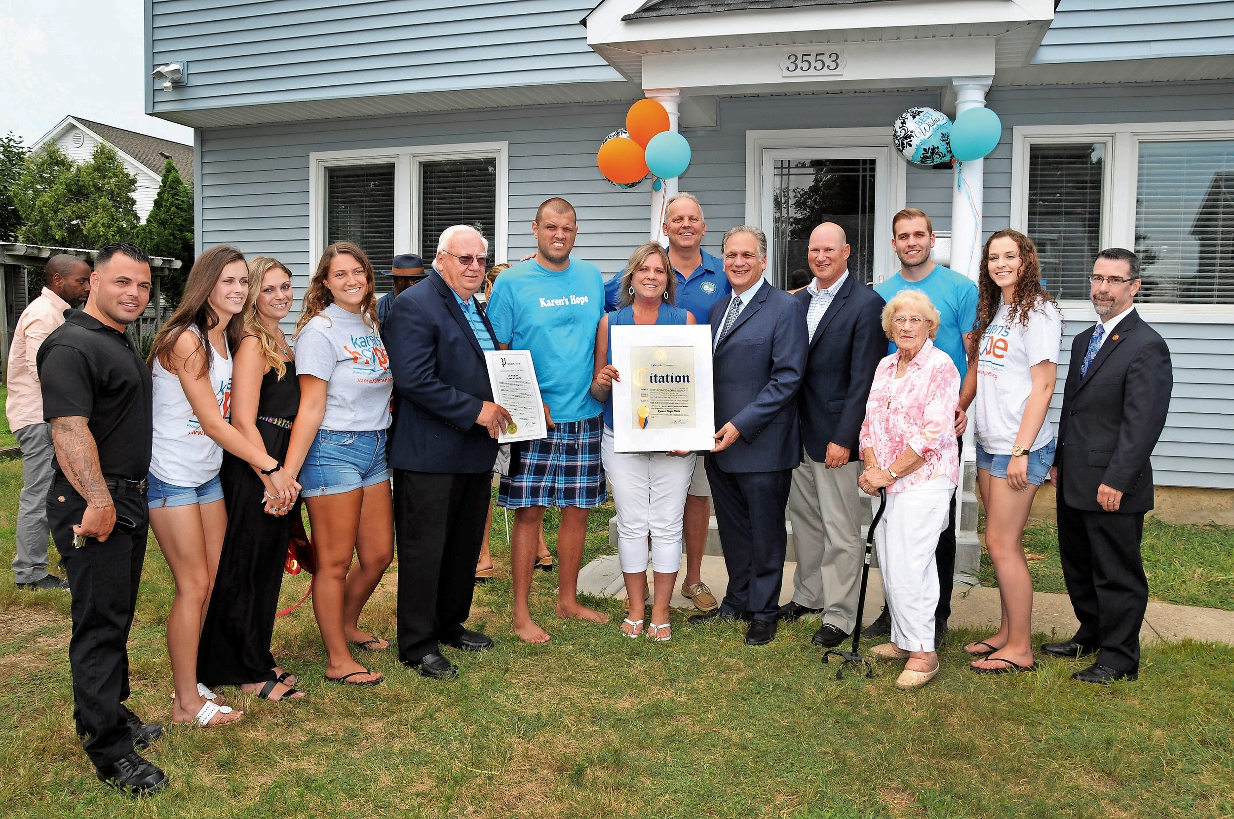 Karen's Hope founders, volunteers, State Sen. John Brooks and County Executive Ed Mangano celebrated the renovation of a house for two disabled adults on July 28.
