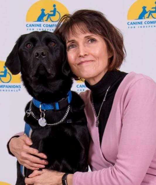Marianne Hutcheson, who conducts art therapy at Mercy Medical Center's outpatient behavioral health services facility in Garden City, has help from Rally II, a trained assistance dog.