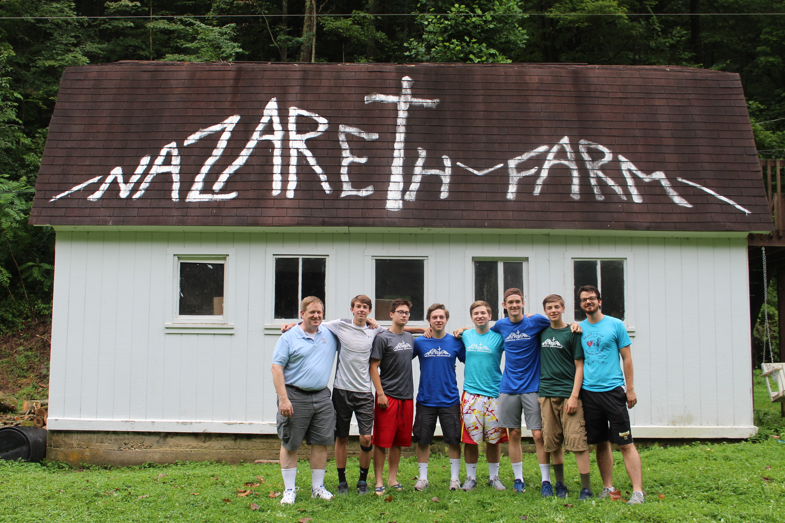 Brother Patrick Sarsfield, left, Nicholas Richardson, John Kenny, Jack Bingham, Aidan Fitzgerald, John Murphy, Brendan Romano and Daniel Haslbauer attended a weeklong community service retreat in West Virginia last month.