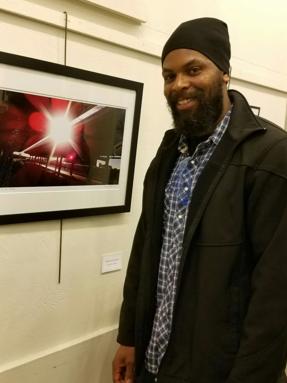 "Amateur photographer Jermaine Ewell's ""Red Sun on the Tracks"" was taken at Jamaica Station, and was displayed in the 37th annual Juried Photography Show at the Freeport Library in June."