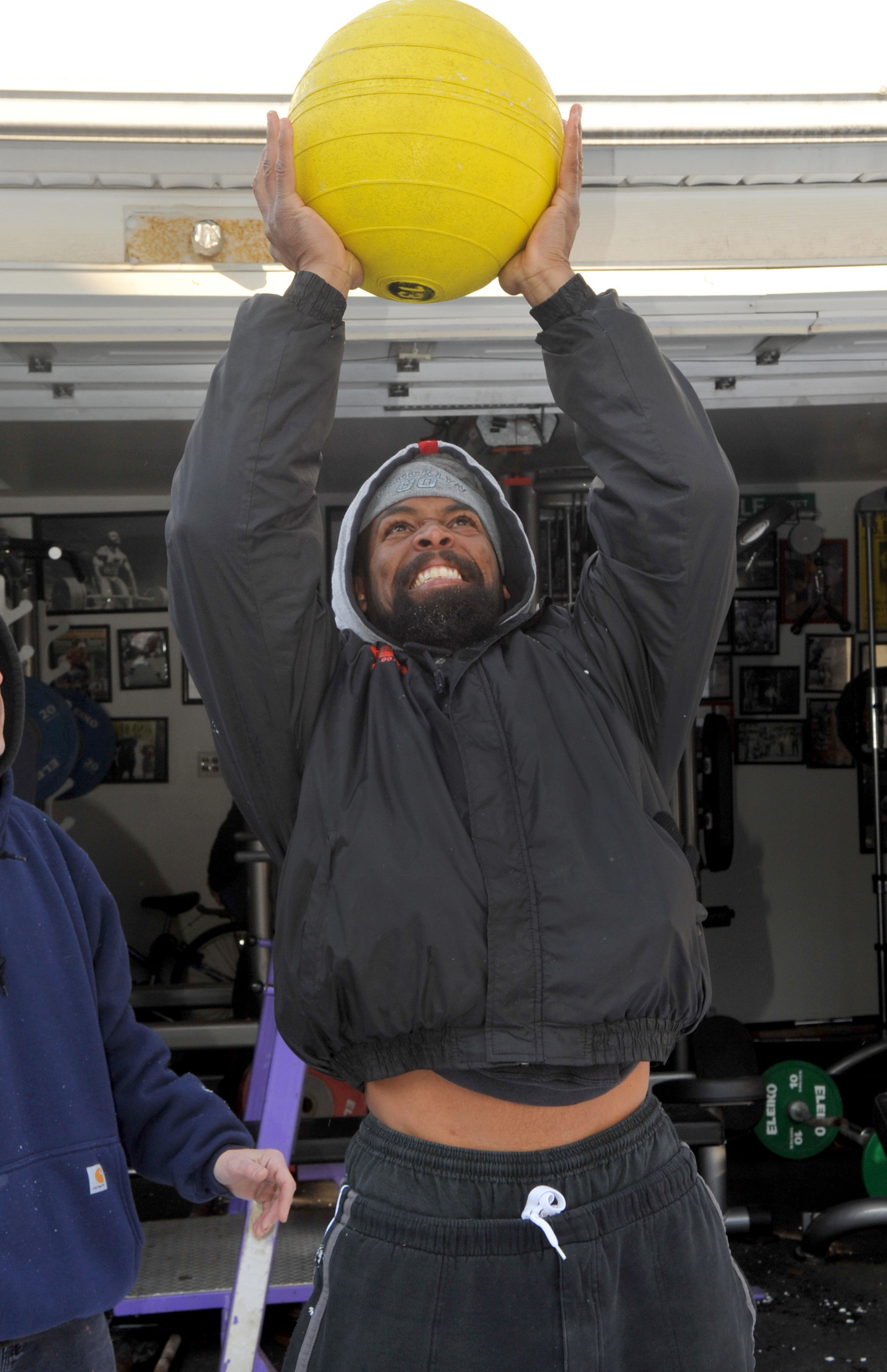 Outside the gym in Kathy and Ken Leistner's garage, Jermaine Ewell lifted a 130-pound medicine ball.