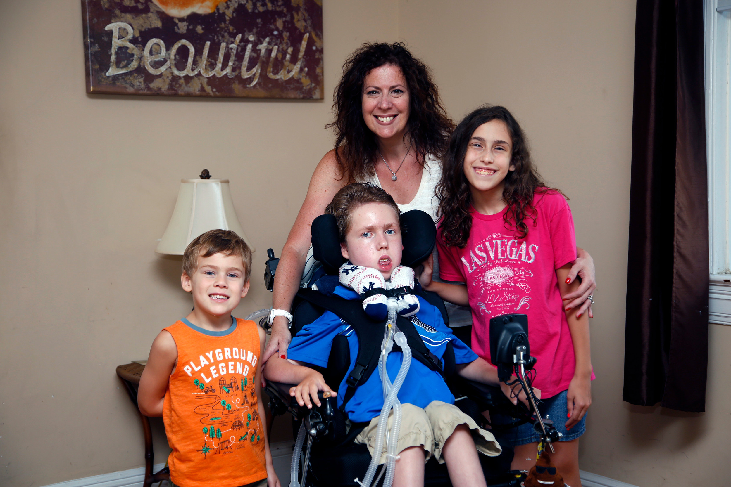 Debbie Cuevas with her children, Nicholas, 4; Dylan, 13; and Heather, 9.