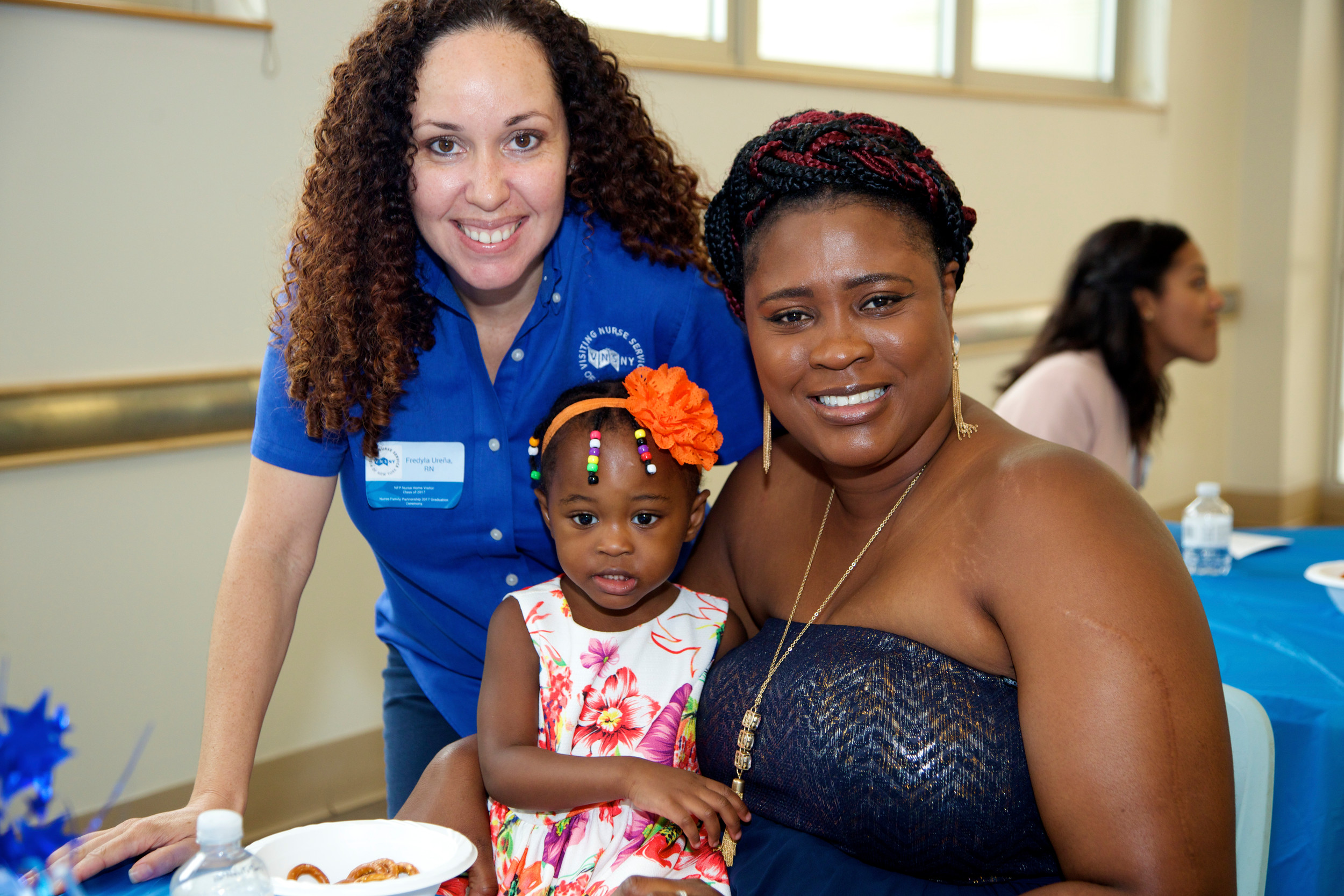 For two years, the Visiting Nurse Service of New York has helped Elmont families grow to be healthy and successful through its Nurse-Family Partnership program. Above, registered nurse Fredyla Urena, left, worked with Simone Foster-Bedward and her daughter Shemaiah Bedward, from Elmont.