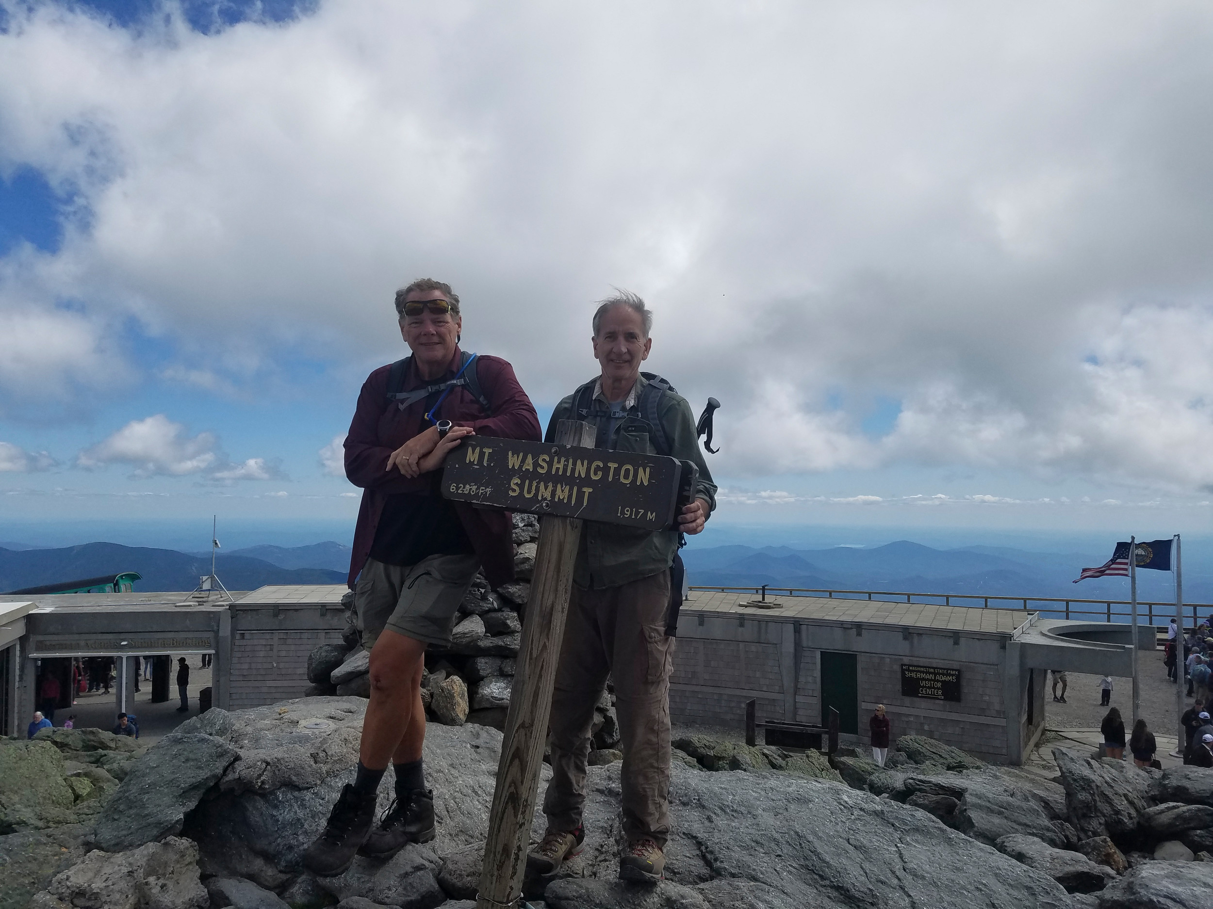 "Fellin, left, and Hymowitz recently climbed Mount Washington, in New Hampshire, as part of Fellin's training. ""It's not easy dragging his butt up a mountain,"" Hymowitz, a lifelong hiker, said of his friend."