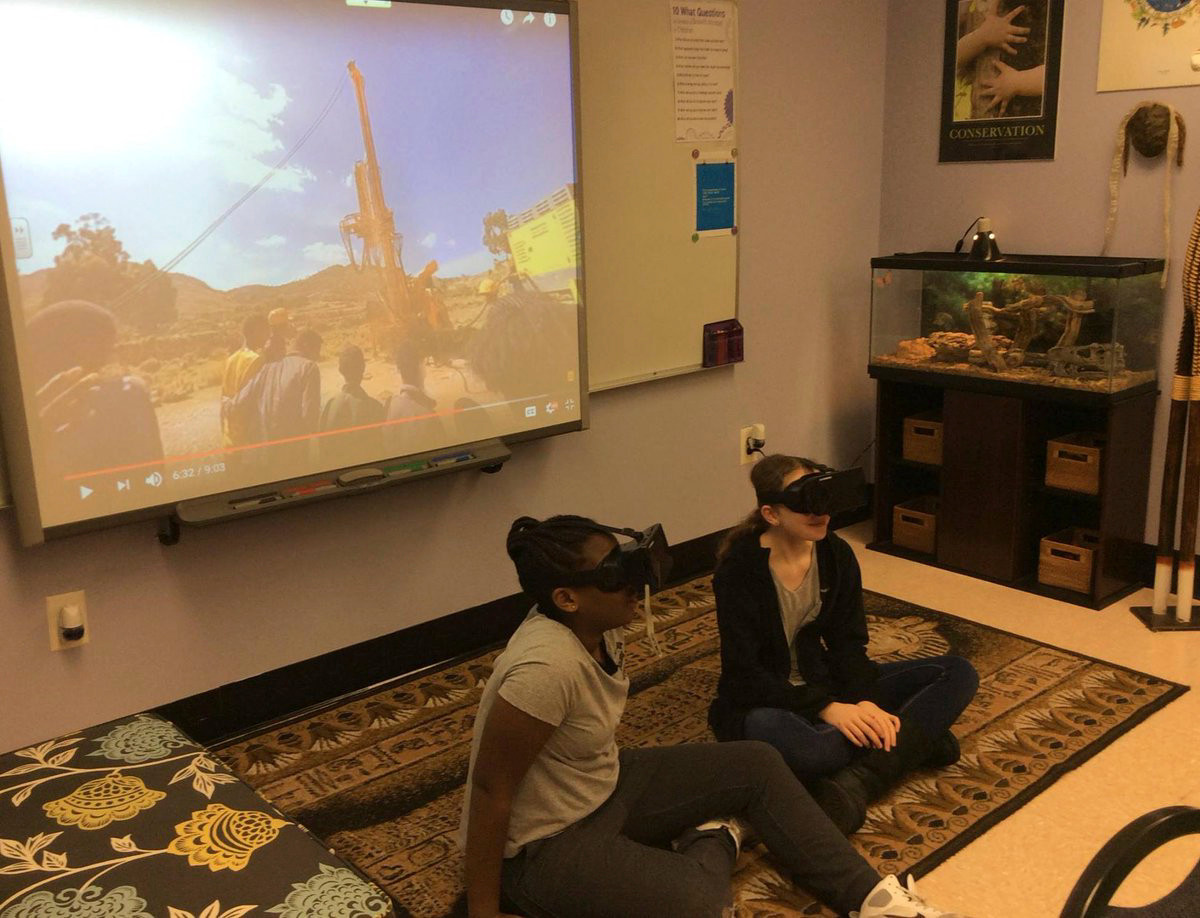 Project EXTRA students Morgan Remy, left, and Nicole Greene take a virtual reality trip to a well construction site