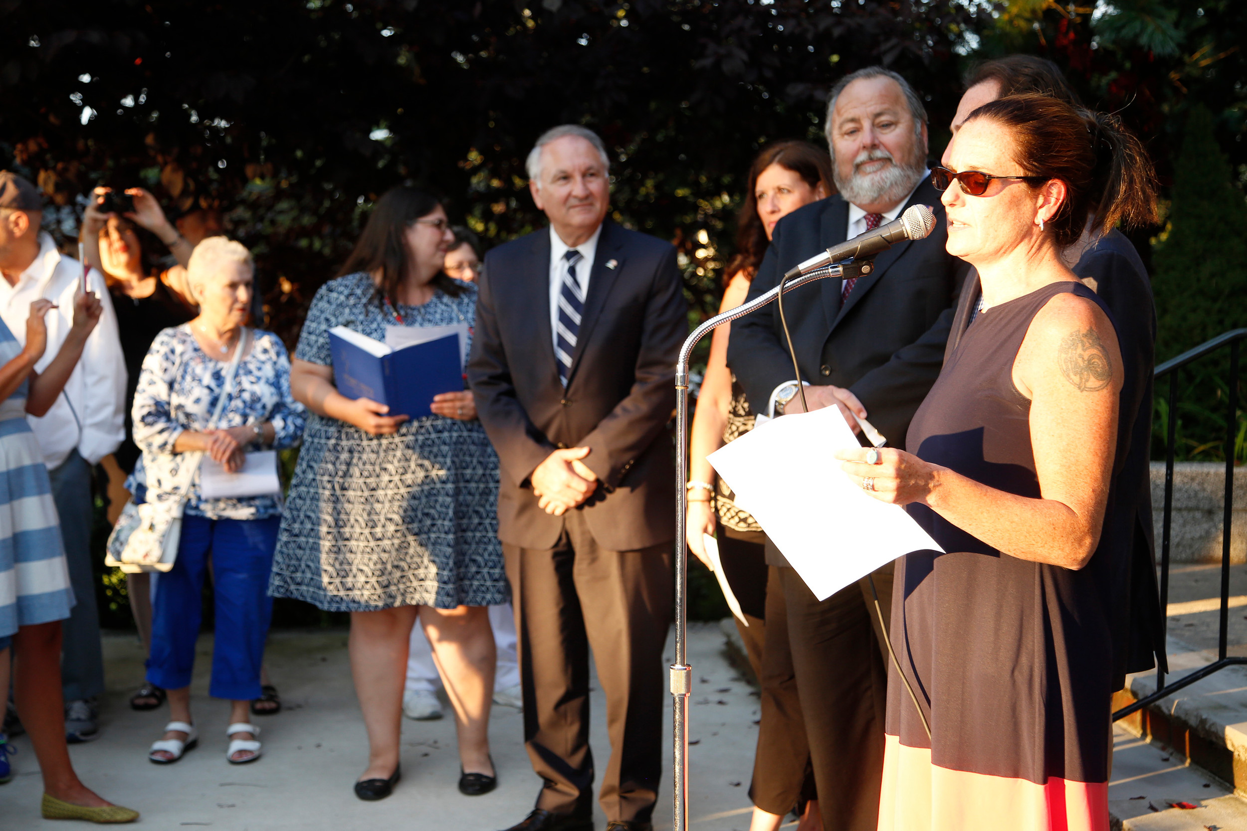 Emma Travers, co-founder of Rockville Centre group Raising Voices USA, who organized the vigil, addressed the crowd.