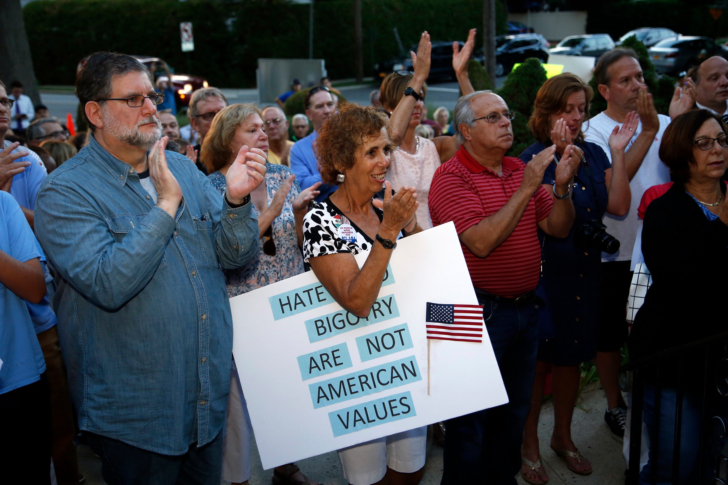 Barbara Sklar, holding her sign, stood beside other residents who denounced hatred and racism at a vigil Thursday night outside Central Synagogue – Beth Emeth in Rockville Centre.