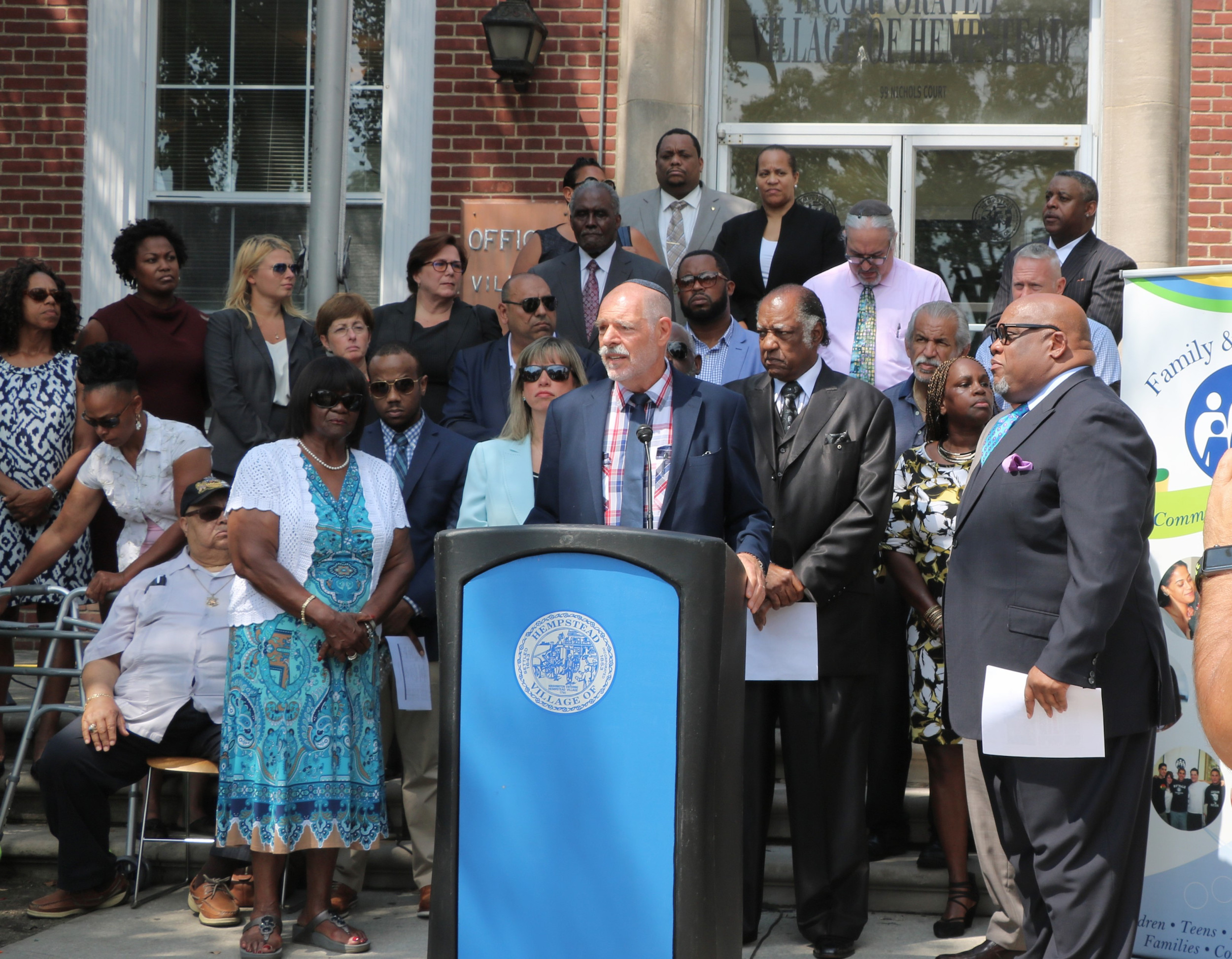 Rabbi Art Vernon, co-chair of the Black-Jewish Coalition for  Justice spoke at a peace rally organized by the coalition in Hempstead village on Aug. 22. Vernon is a rabbi at Congregation Shaaray Shalom in West Hempstead. Coalition co-chair Rev. Dr. William Watson is to his immediate right.