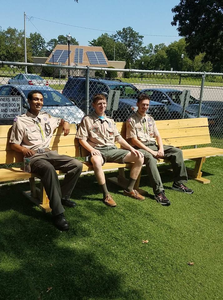Jason Bitetto, center, and his brother, Matthew, left, and father Tony, right, showed off the new benches on Aug. 13, which he built as part of his Eagle Scout project.