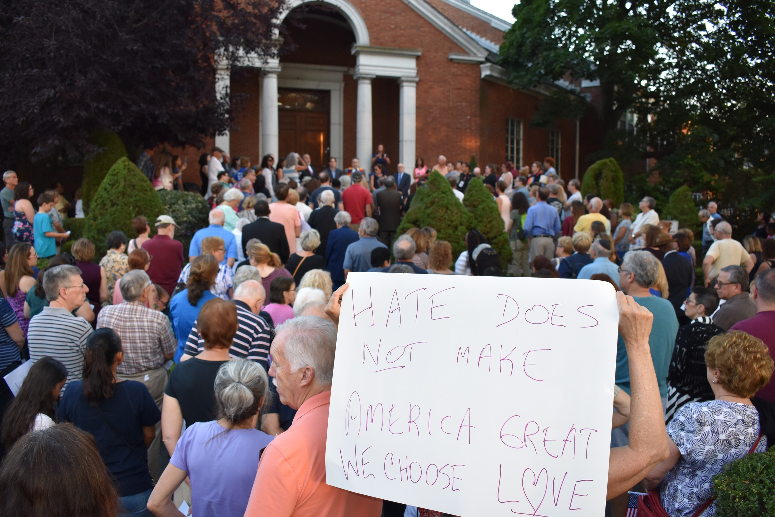 People gathered at the steps of Central Synagogue-Beth Emeth to denounce hatred and racism at a vigil on Aug. 17, in response to the violence in Charlottesville, Va., a few days earlier.