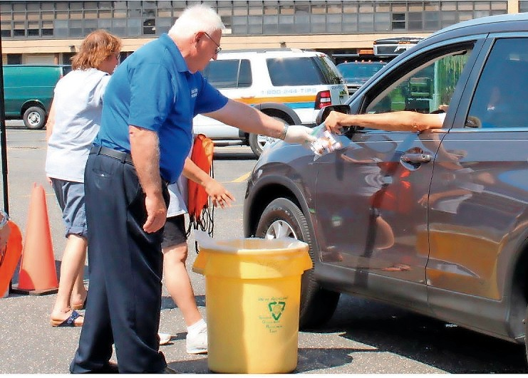 State sen. John Brooks dropped community members' expired medications into safe bins at the Drug Take-Back Day event on Aug. 19