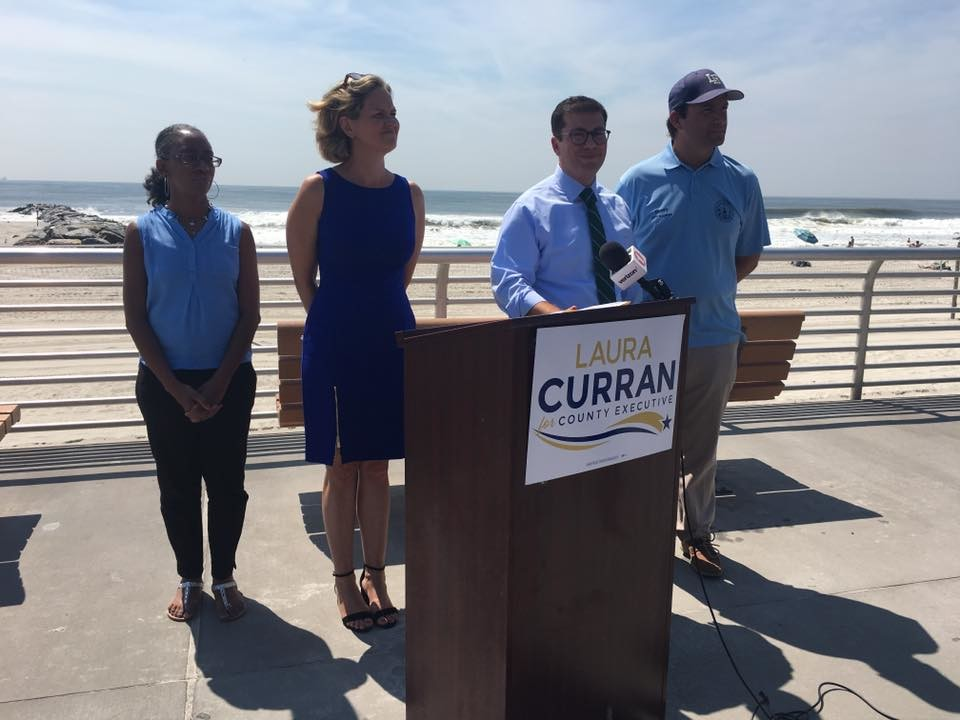 Nassau County Legislator Laura Curran, second from left, a Democratic candidate for county executive pledged on Aug. 16 at a news conference on the Long Beach boardwalk that if she's elected, she would ensure that taxpayer-funded infrastructure projects are built to be more resilient at a time when climate change is impacting the environment. With her were City Councilwoman Anissa Moore, left, City Manager Jack Schnirman and council Vice President Anthony Eramo.