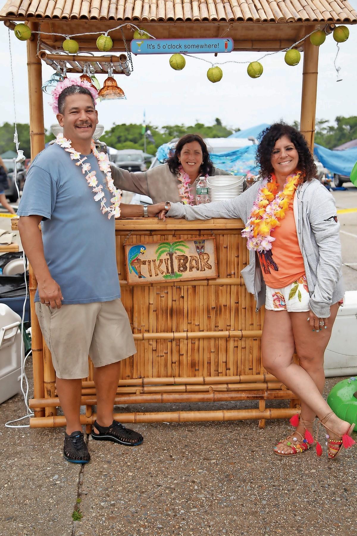 Stanley Parnes, left, Denise Lombardi and Holly Sands, right, sipped on some drinks at their personal tiki bar.