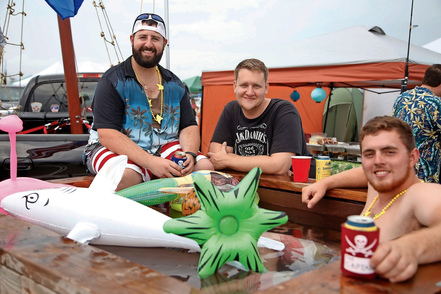 Parrot Head fans went all out for the tailgate. From left, Tony DeCaesar, James Mattes and Nick Fondacaro soaked in their private pirate ship hot tub.