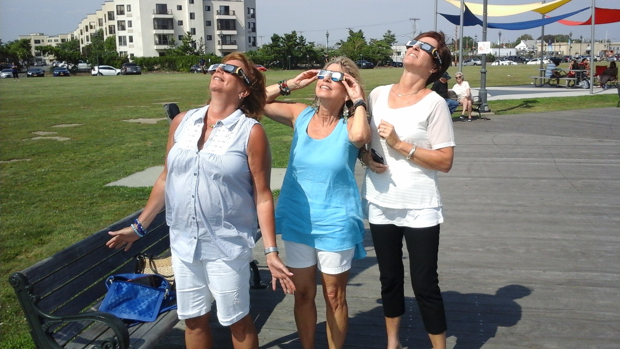 After having lunch at Rachel's on the Nautical Mile, friends Mary Wolfson, far left, Marianne Wiser and Gail Eisenberg watched from Seabreeze Park.