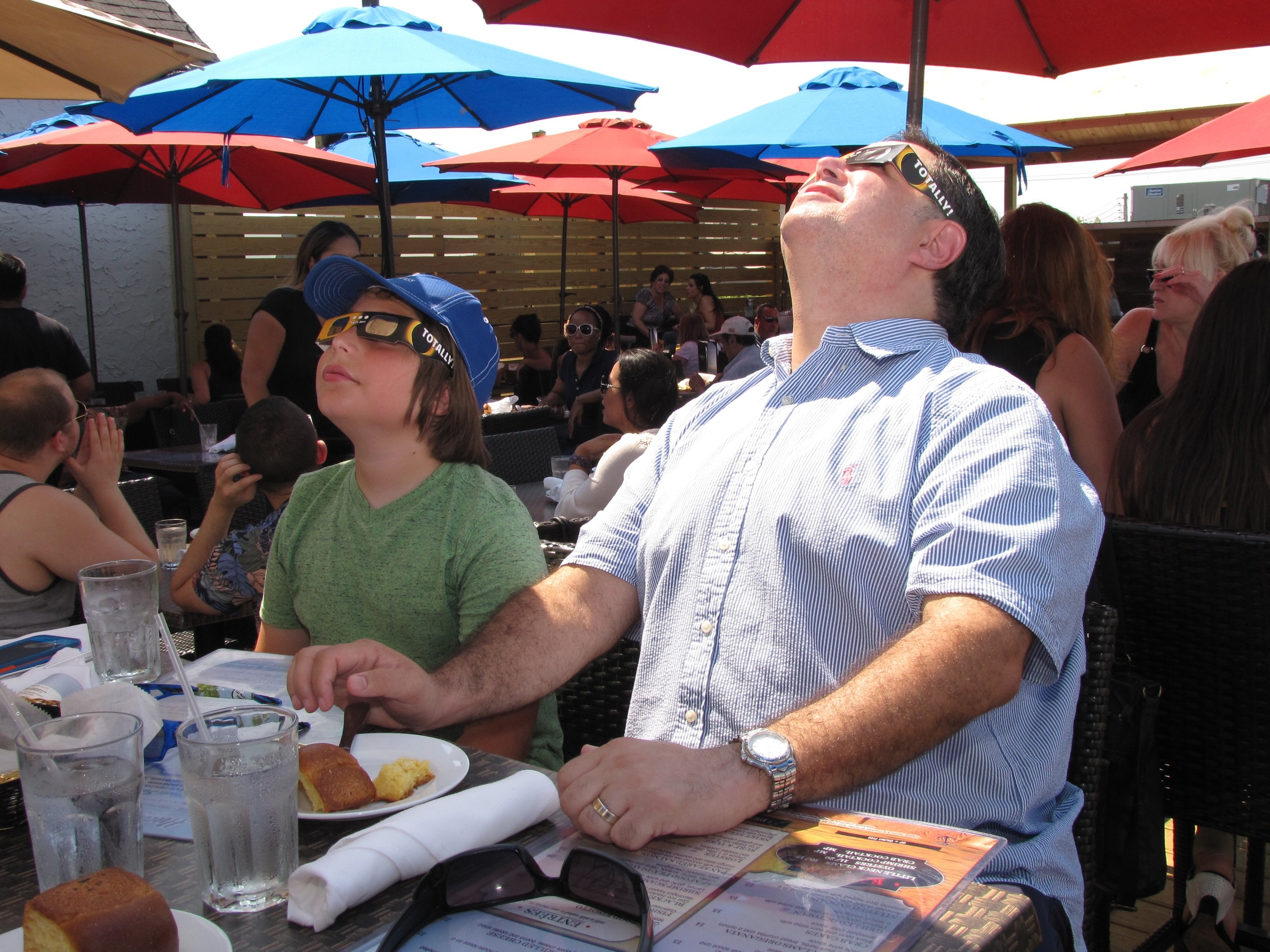 After grabbing lunch, father and son Ross and David Schiller got a glimpse of the astronomical goings-on.