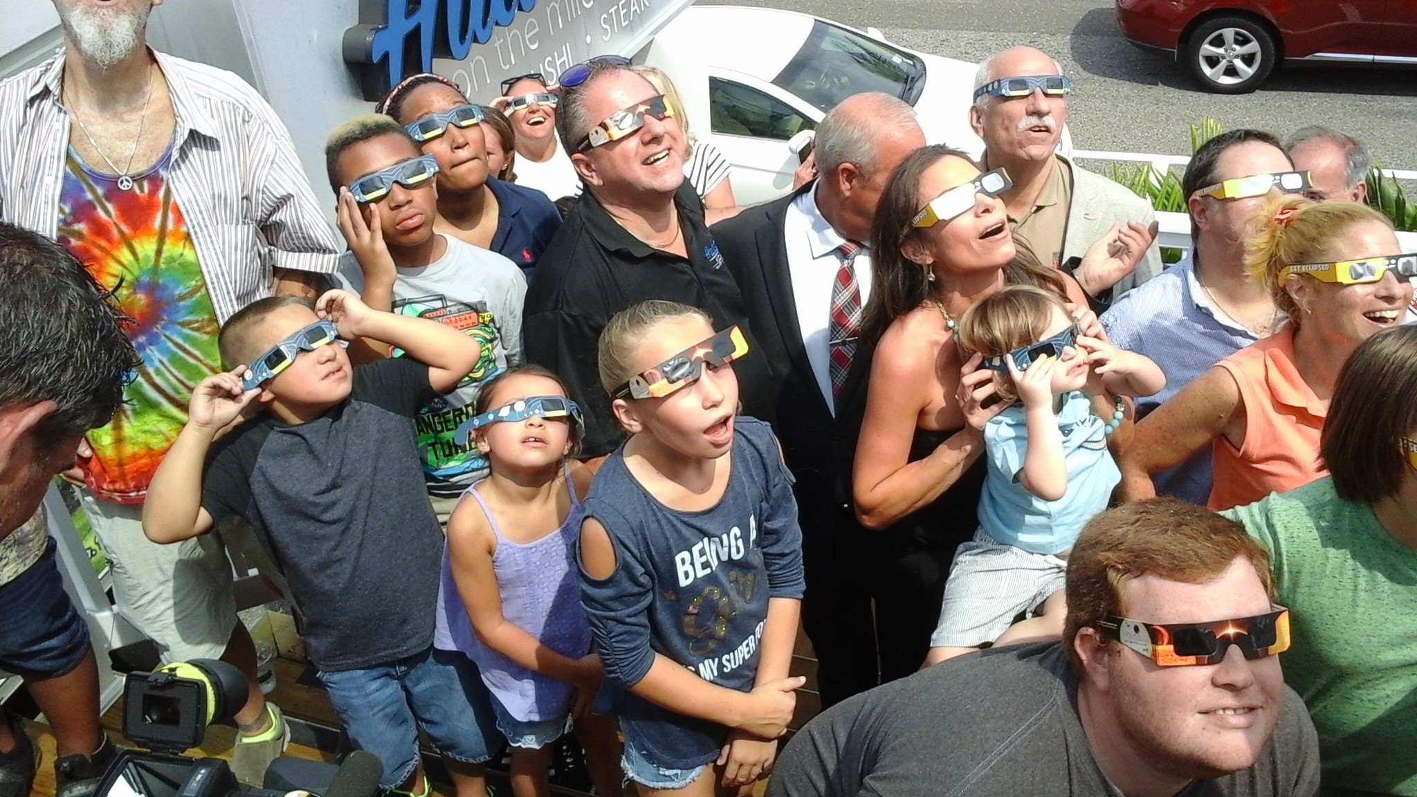 Spectators gathered at Hudson's on the Mile, off Woodcleft Avenue, in Freeport on Monday to watch the solar eclipse on the newly open solar deck.
