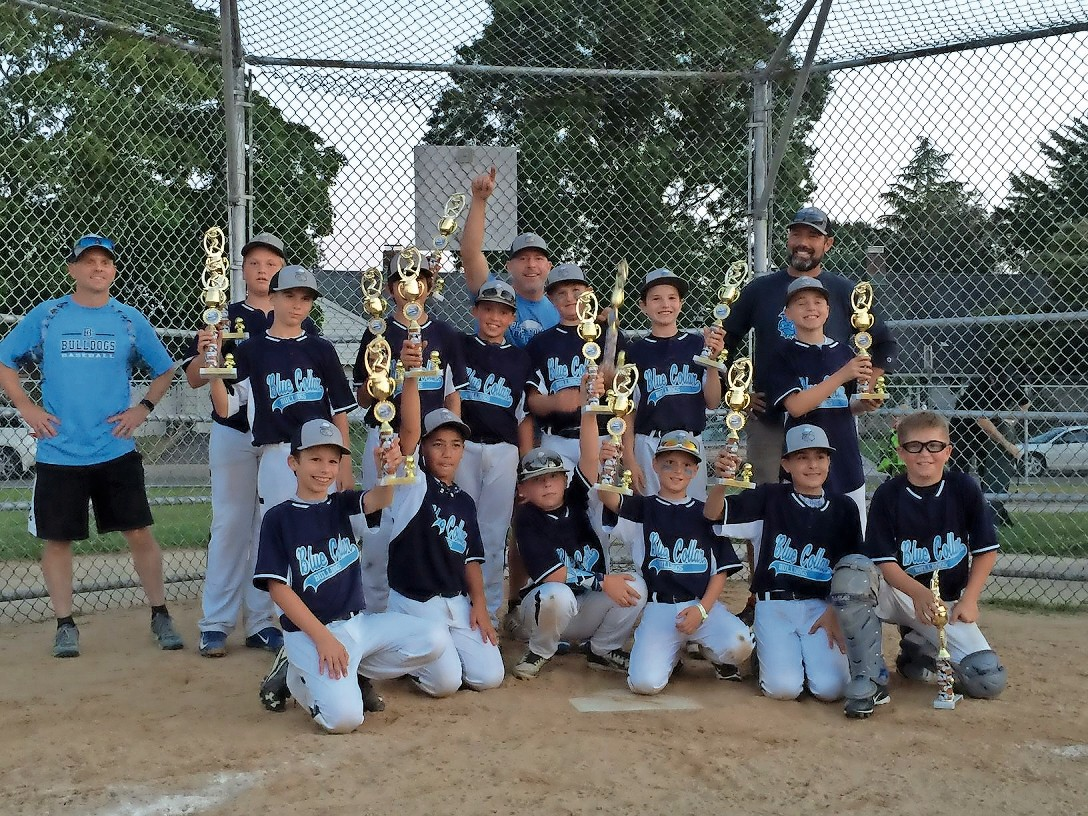 The Blue Collar Bulldogs were grinning from ear to ear as they hoisted their championship trophies.
