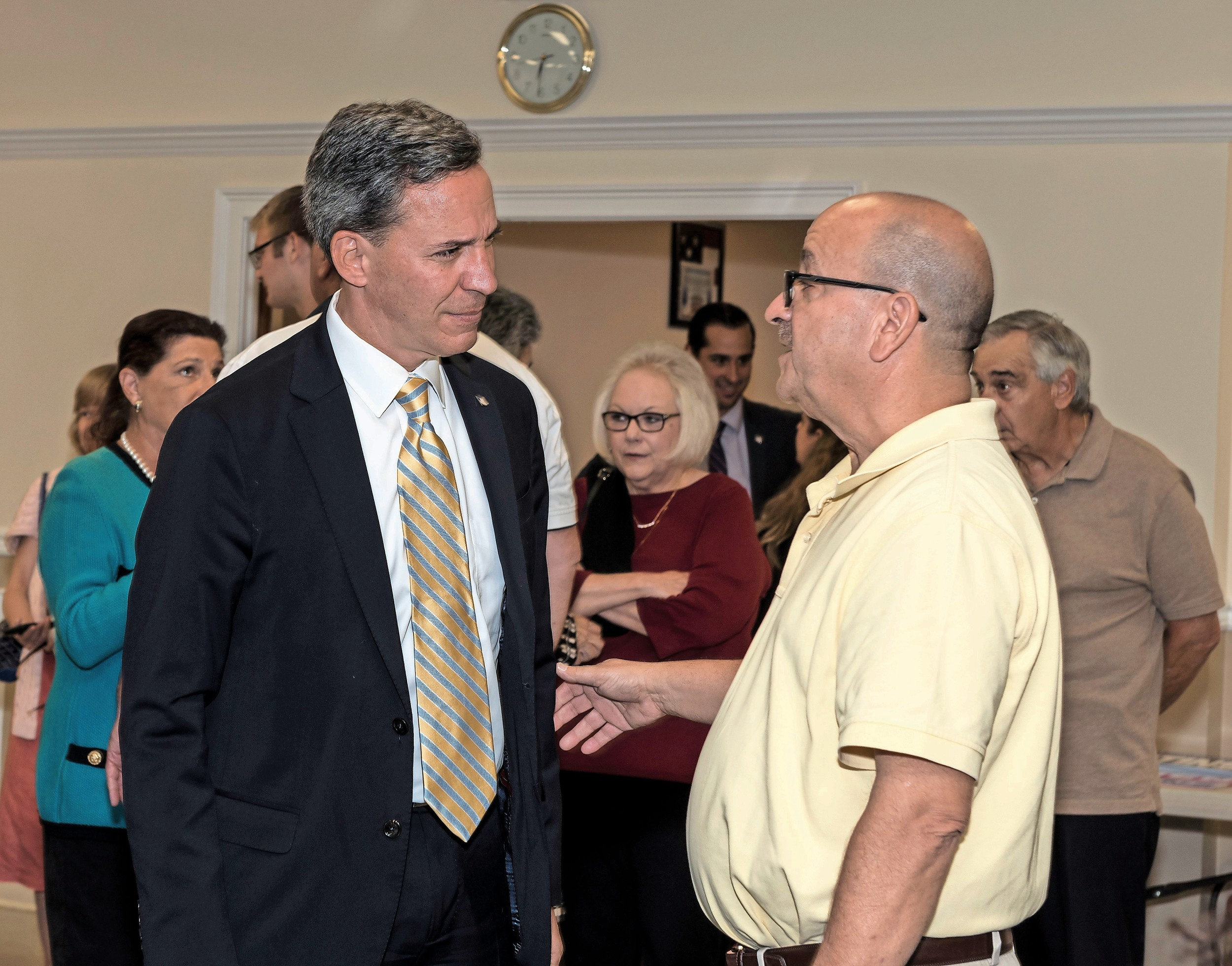 Sen. Jack Martins, left, met with residents and local leaders in Glen Cove, including the Glen Cove Republican Club's executive leader, David Zatlin, as Martin campaigned for county executive.