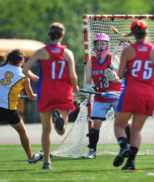 "South Side High School goalie Kelsey Gregerson, No. 13, pictured in 2010, was the ""backbone"" of the Cyclones squad."