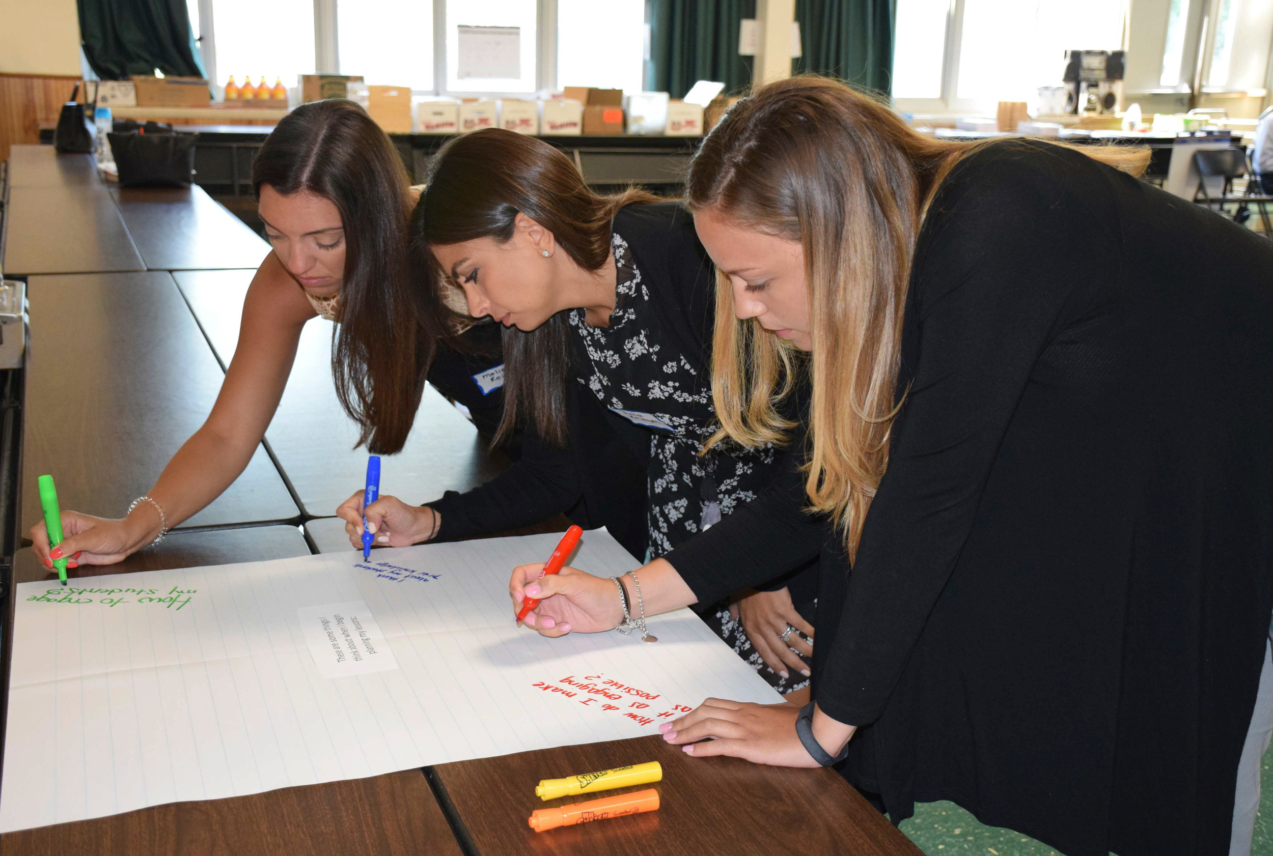 New teachers, from left, Melissa Reime, Julia Kriegel and Emma Hintz, shared their thoughts on how to create engaging lessons for students.
