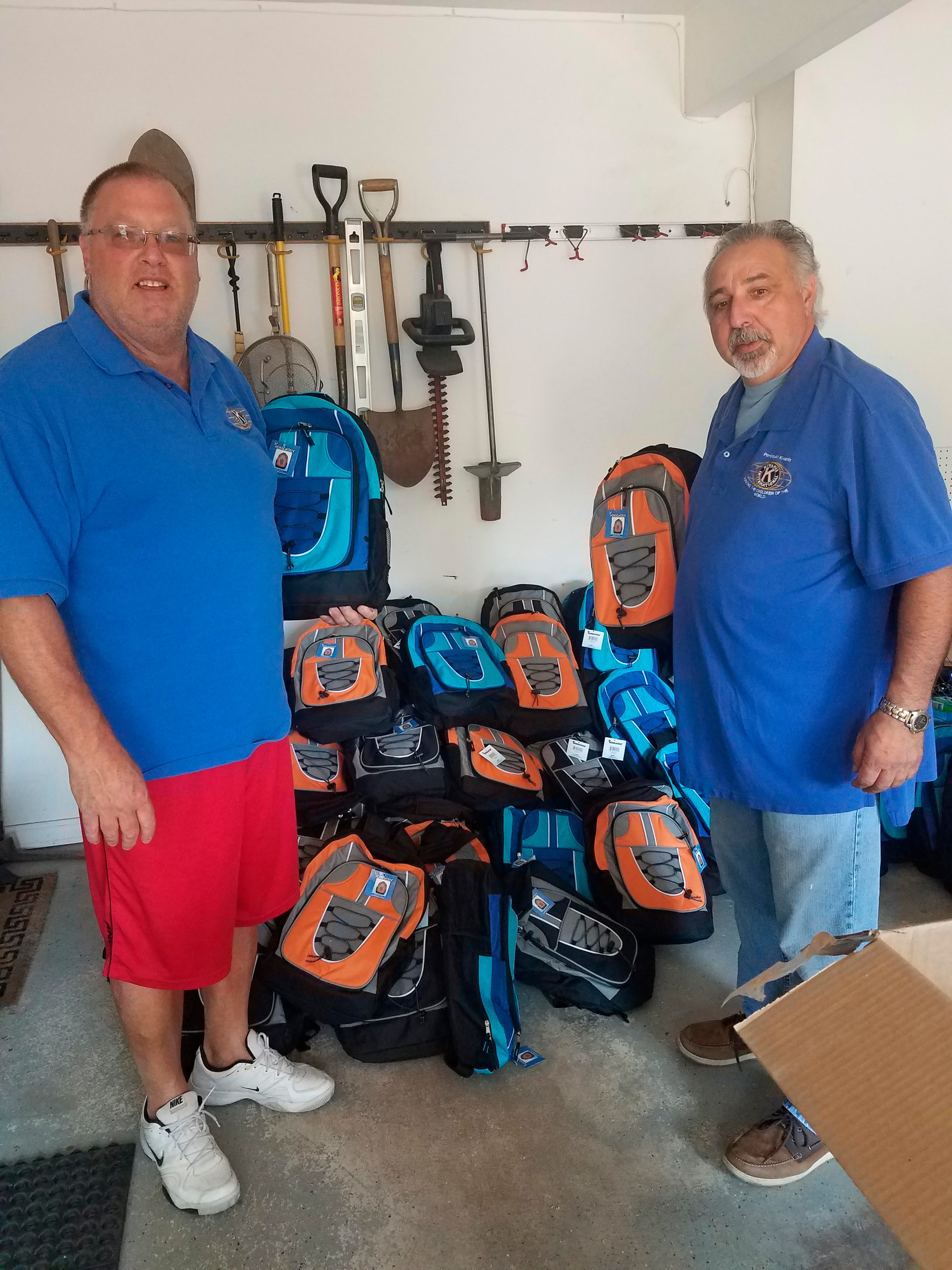 Backpacks filled with school supplies, toothbrushes and toothpaste were donated to three local school districts by Peninsula Kiwanis. Above, Program Chairman Bill Dubin, left, and Peninsula Kiwanis President Dominick Curra.