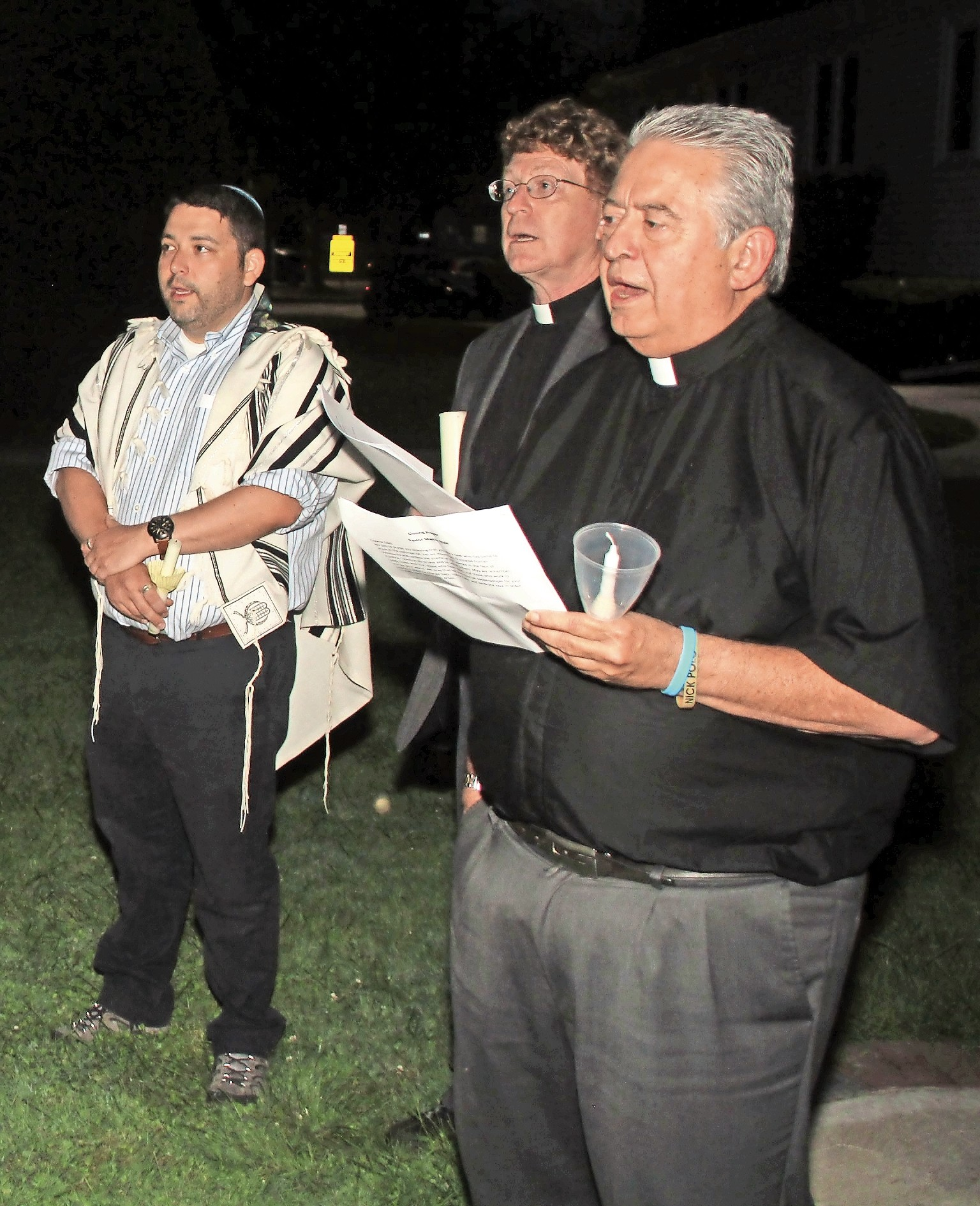 Rabbi Daniel Bar-Nahum, far left, of Temple Emanu-El of East Meadow; the Rev. Martin Nale, pastor of Christ Lutheran Church of Wantagh; and the Rev. Gregory Cappuccino, pastor of St. Frances de Chantal Roman Catholic Church, in Wantagh, sang the national anthem.