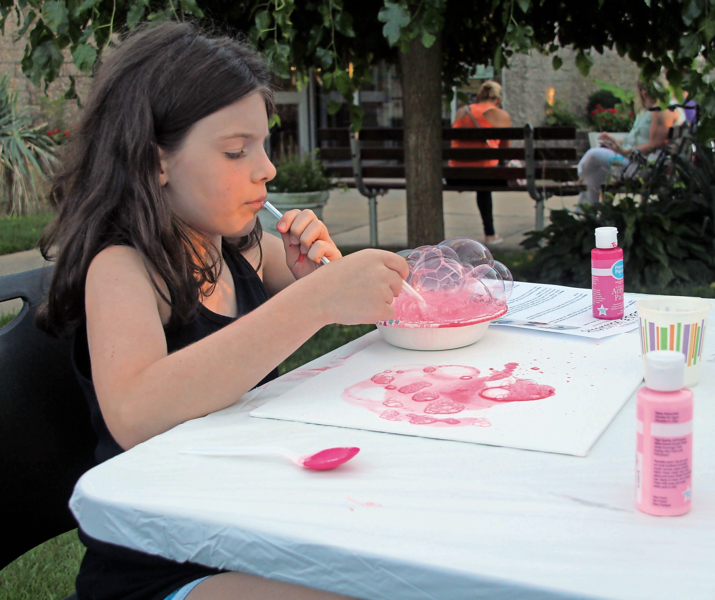 Sophia Zanelotti, 9, blew pink bubbles using soap and paint.