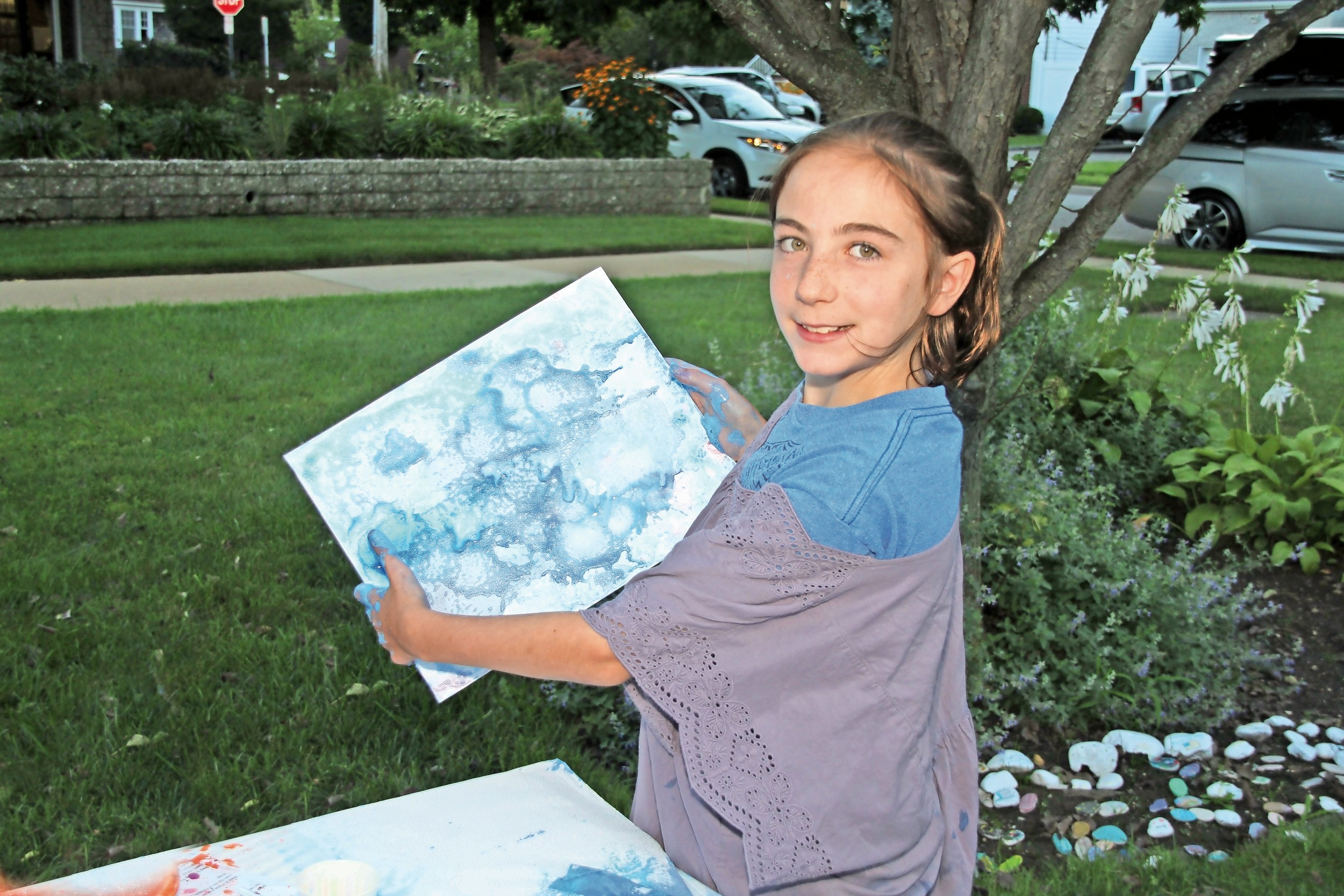 Arielle Combs, 12, showed off her painting.