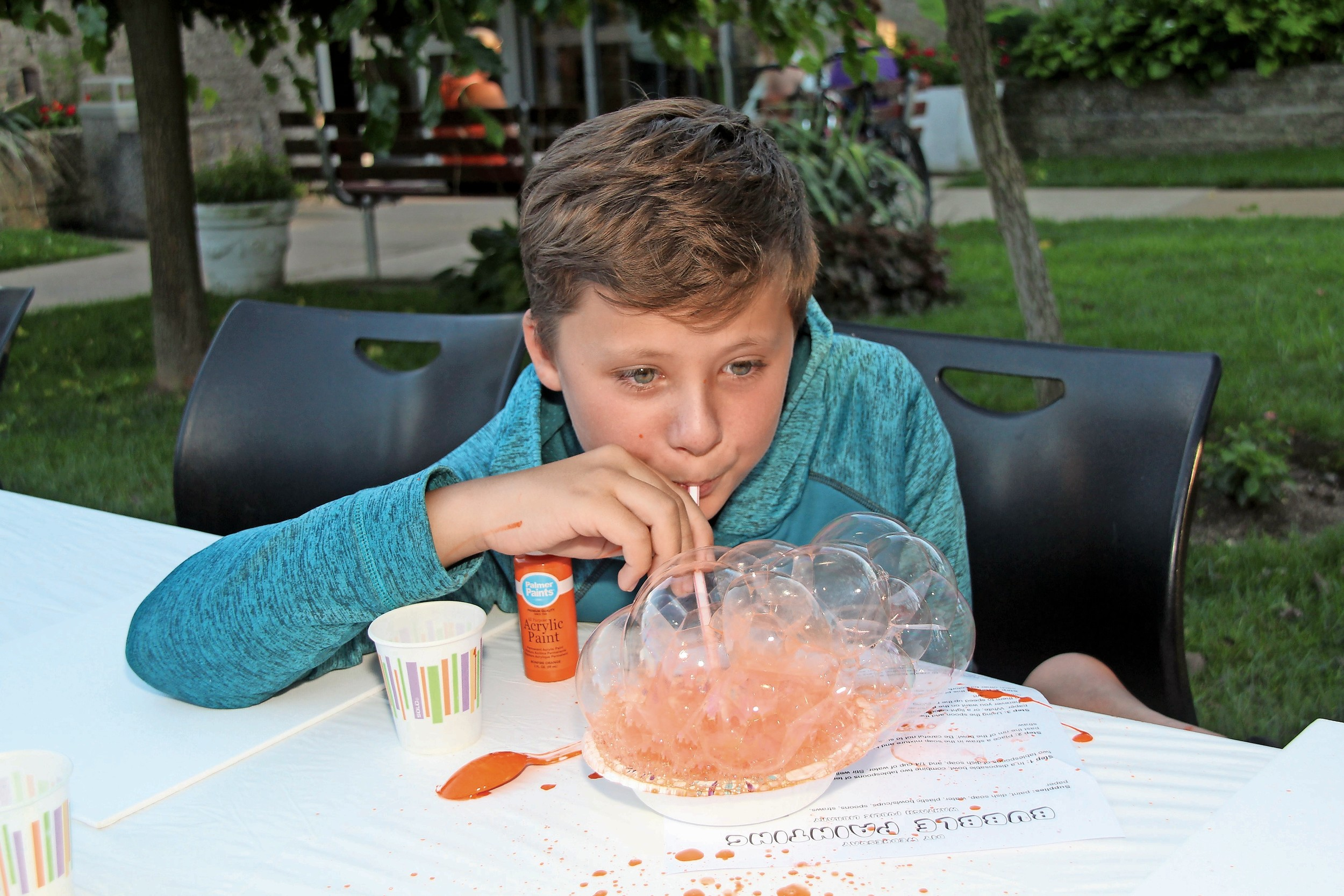 John Haubeil, 11, created a bubble painting at the Wantagh Public Library on Aug. 23.