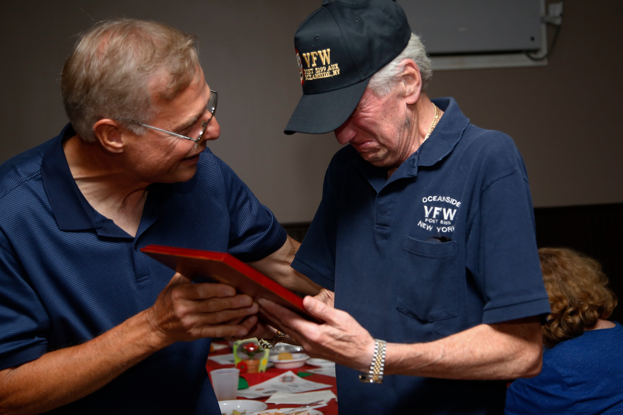 Kiesche, right, became emotional when he was surprised with an award on Aug. 13 honoring his decades of charity and community service supporting local veterans.